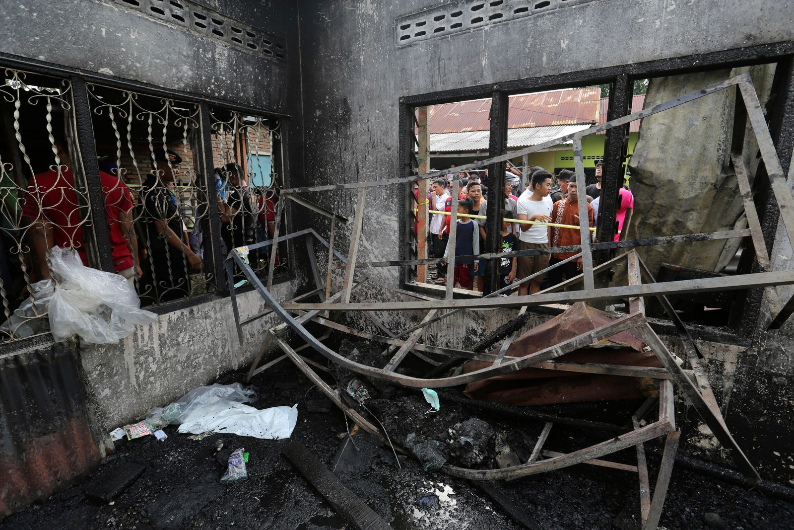 Residents examine the damage after a fire razed through a match factory in Langkat, North Sumatra, Indonesia, Friday, June 21, 2019.{ } (AP Photo)