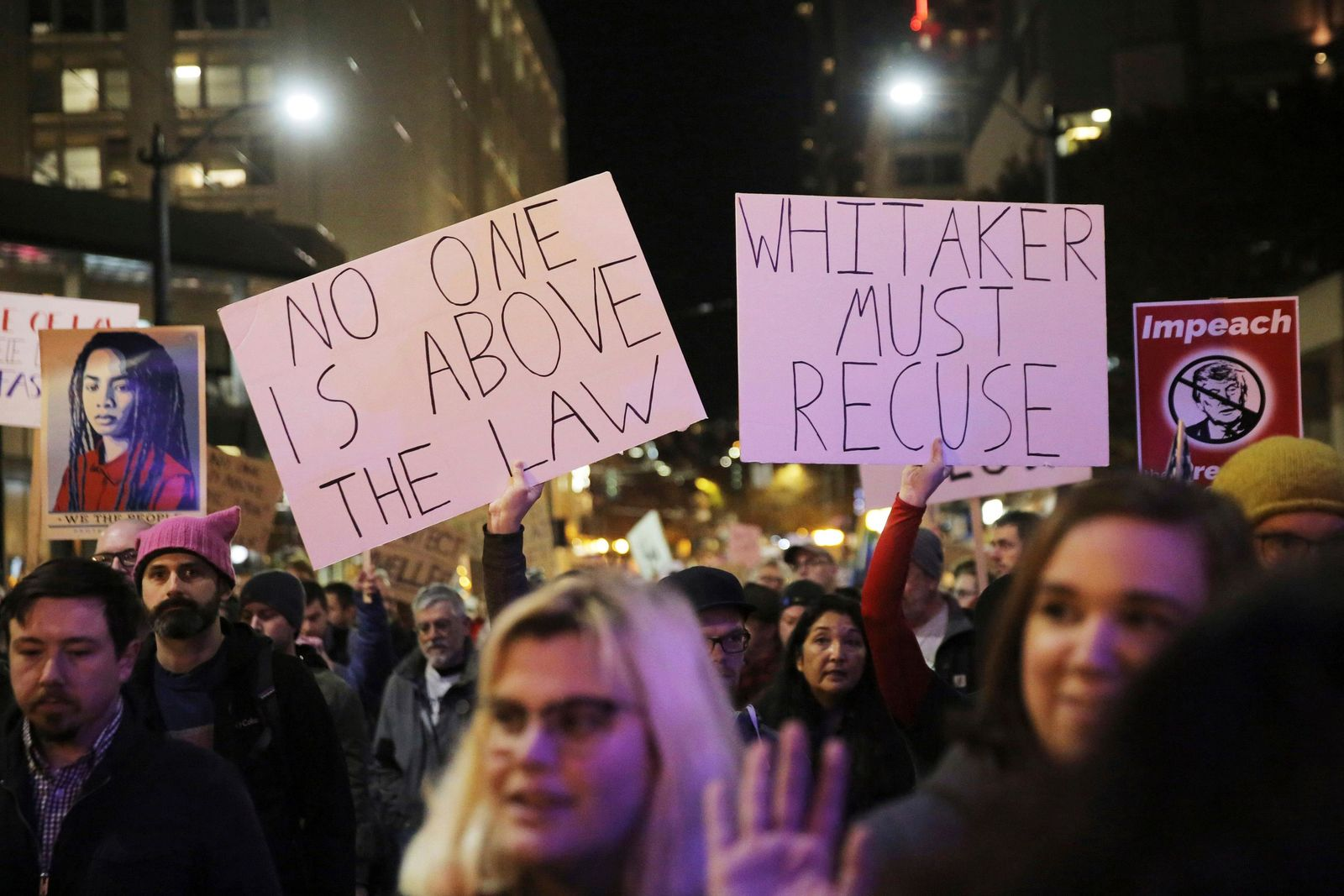 Protesters march from Cal Anderson Park to the Federal Building downtown in Seattle, in support of special counsel Robert Mueller.{ } (Genna Martin/seattlepi.com via AP)