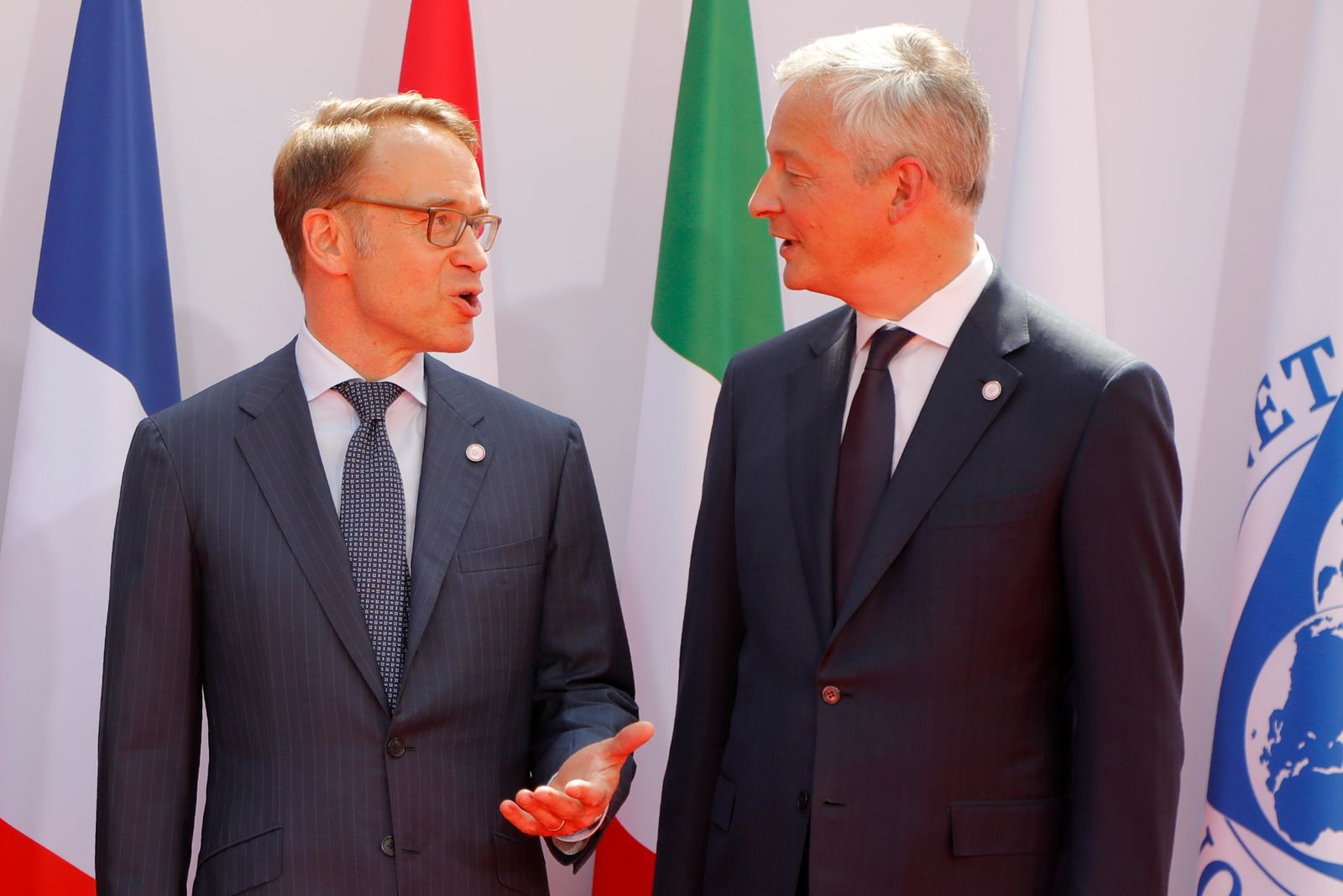 French Finance Minister Bruno Le Maire, right, welcomes German Bundesbank President Jens Weidmann at the G-7 Finance Wednesday July 17, 2019 in Chantilly, north of Paris.{ } (AP Photo/Michel Euler)