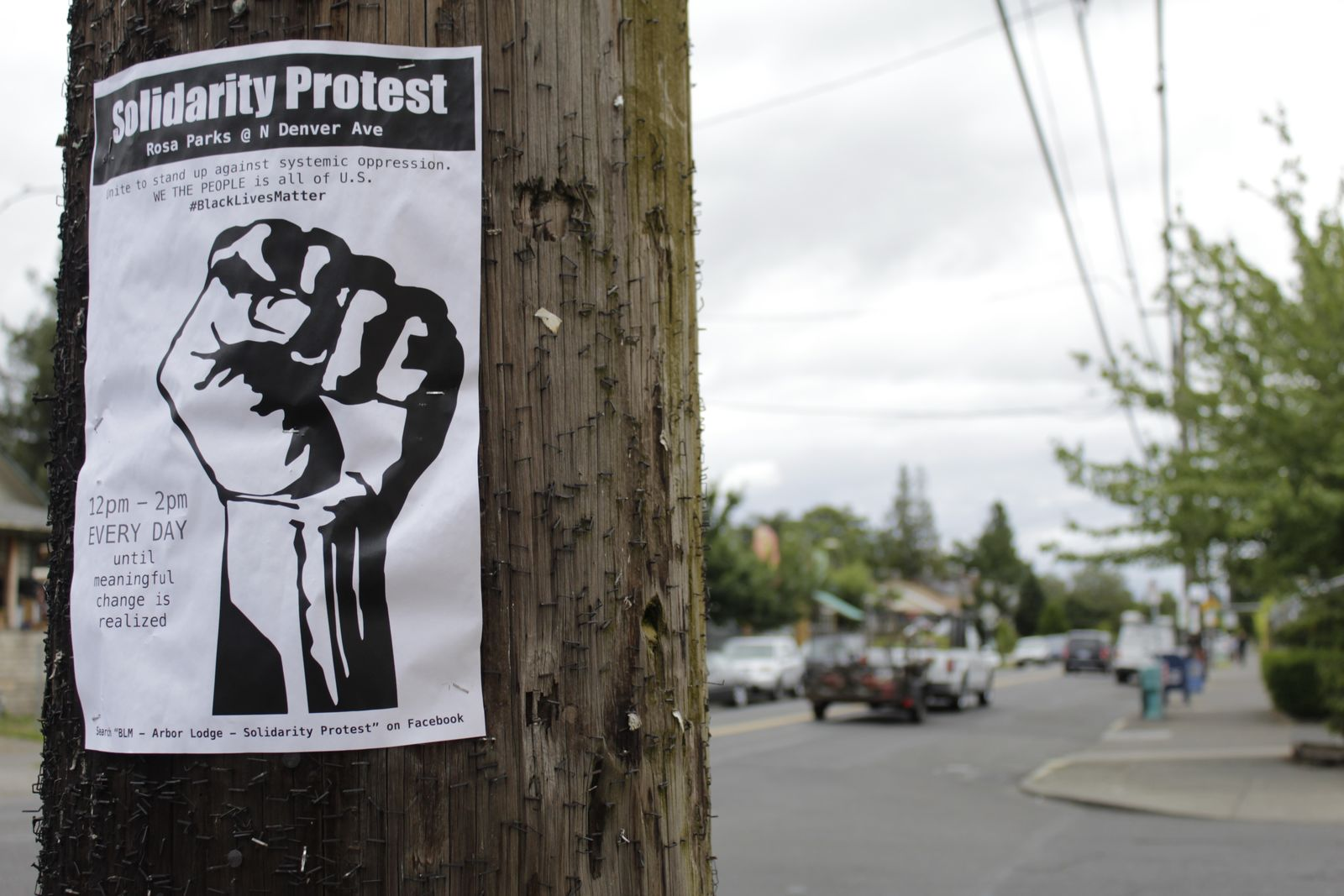 A sign advertising a daily protest in solidarity with Black Lives Matter is affixed to a telephone pole in a historically Black neighborhood in Portland, Ore., on Wednesday, July 1 2020. (AP Photo/Gillian Flaccus)