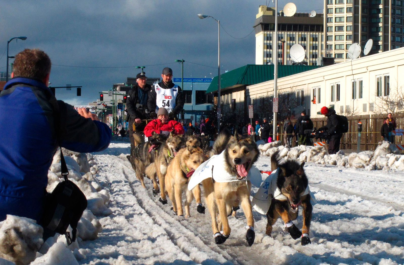 FILE - In this March 7, 2015, file photo, musher Peter Kaiser, of Bethel, Alaska, leads his team past spectators during the ceremonial start of the Iditarod Trail Sled Dog Race, in Anchorage, Alaska. (AP Photo/Rachel D'Oro, File)