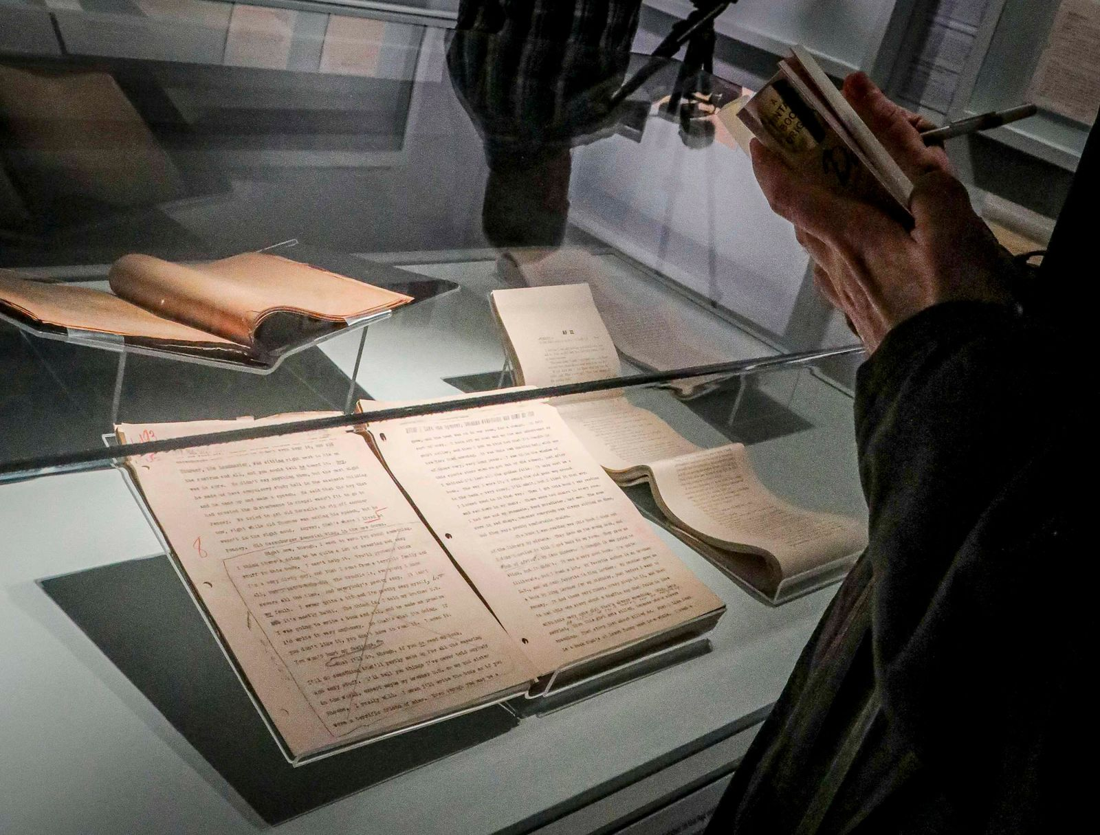 "An early draft of the 1951 novel ""The Catcher in the Rye"" is part of a J.D. Salinger exhibit being installed at the New York Public Library, Wednesday, Oct. 16, 2019, in New York.{ } (AP Photo/Bebeto Matthews)"