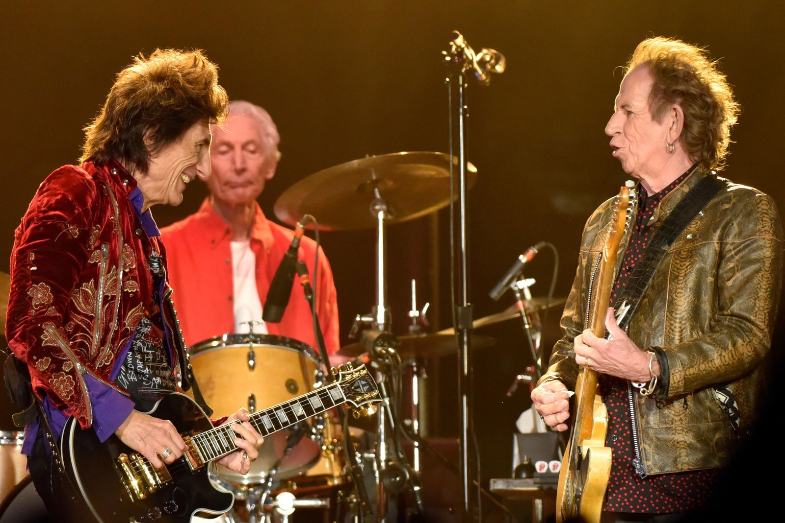 "Ron Wood, left, Charlie Watts, and Keith Richards, right, of the Rolling Stones performs during the ""No Filter"" tour at Soldier Field on Friday, June 21, 2019, in Chicago. (Photo by Rob Grabowski/Invision/AP)"