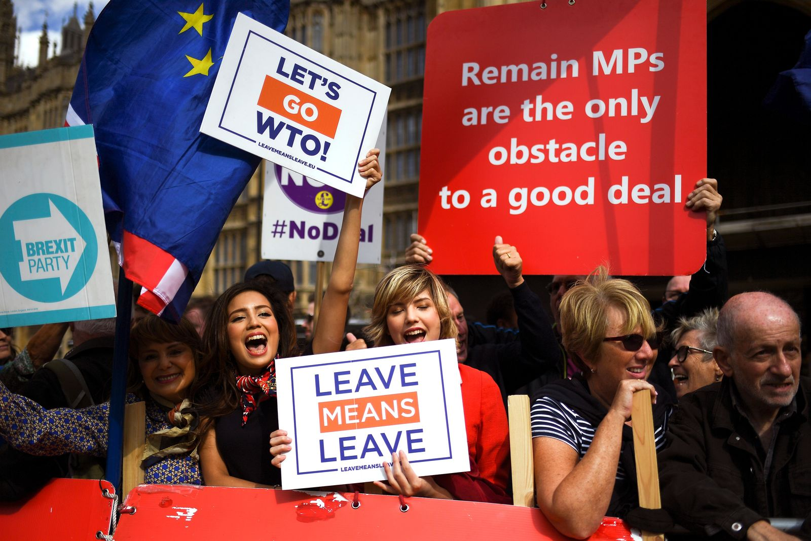 Pro-Brexit supporters outside the Houses of Parliament, in London, Wednesday, Sept. 4, 2019.{ } (AP Photo/Alberto Pezzali)