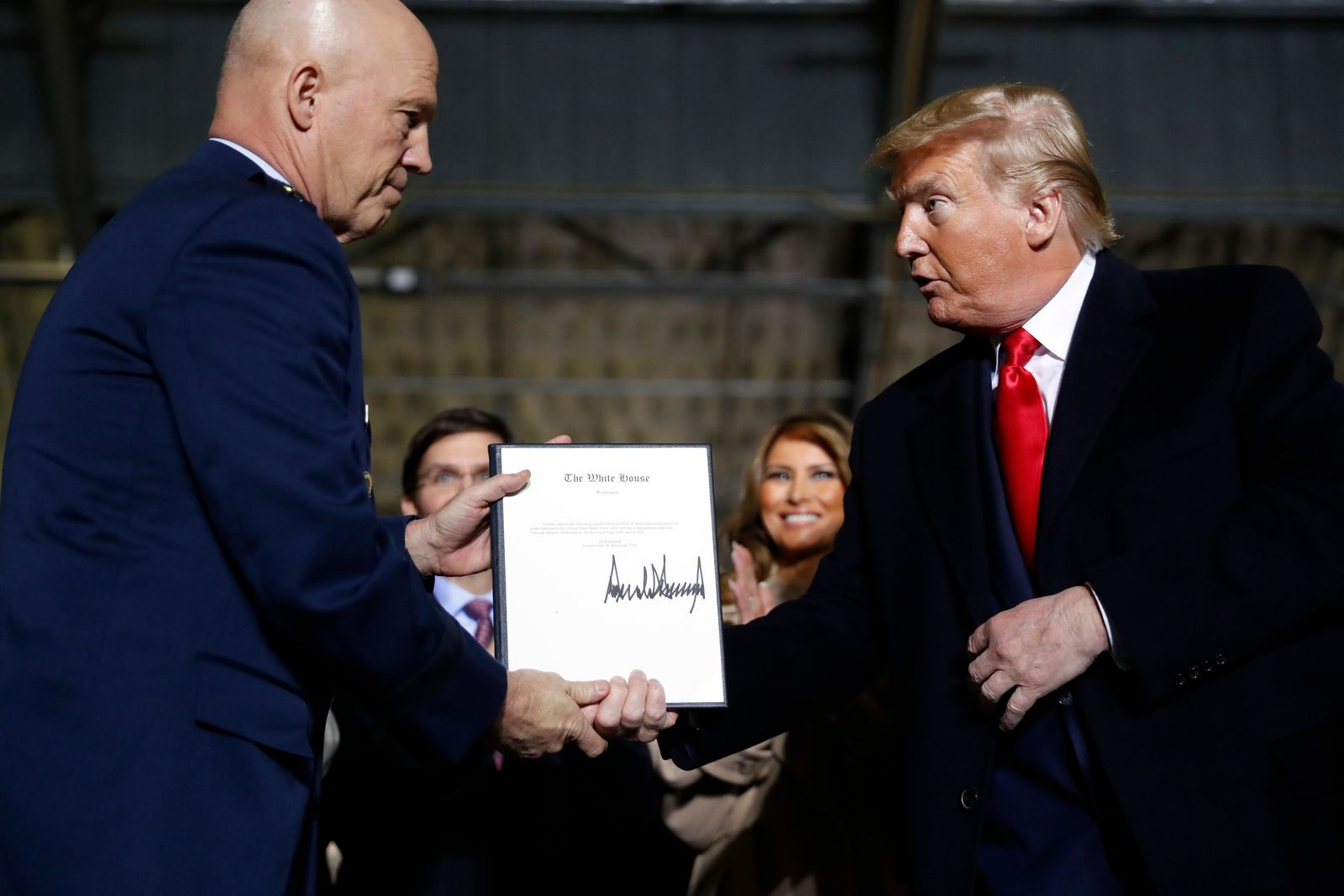 President Donald Trump shakes hands with Gen. Jay Raymond, after signing the letter of his appointment as the chief of space operations for U.S. Space Command during a signing ceremony for the National Defense Authorization Act for Fiscal Year 2020 at Andrews Air Force Base, Md., Friday, Dec. 20, 2019. (AP Photo/Andrew Harnik)