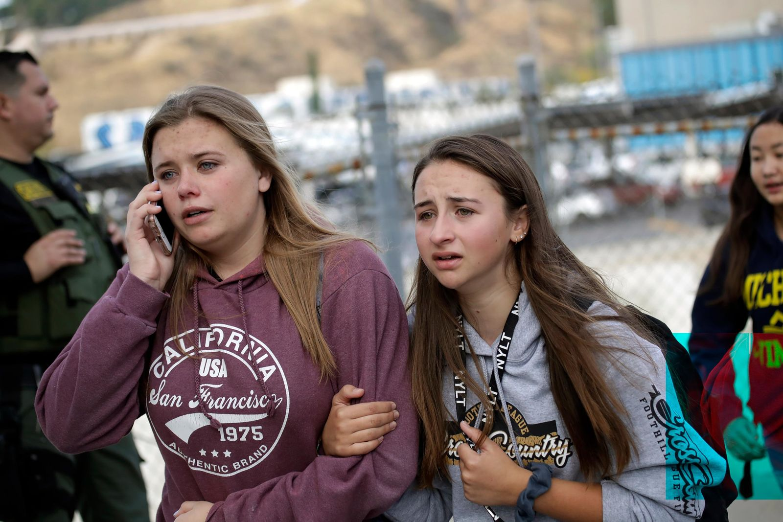 Students are escorted outside of Saugus High School after reports of a shooting on Thursday, Nov. 14, 2019, in Santa Clarita, Calif. Los Angeles County Sheriff Alex Villanueva tweeted that the suspect was in custody and was being treated at a hospital. He said the suspect was a student but gave no further information. (AP Photo/Marcio Jose Sanchez)