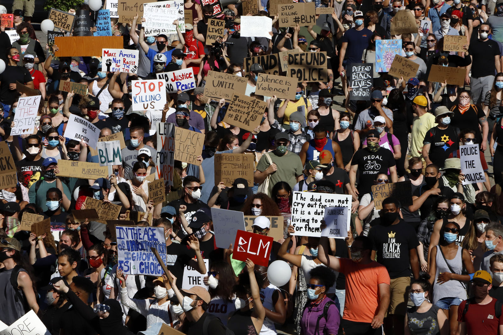 FILE - In this June 7, 2020, file photo, protesters participating in a Black Lives Matter rally march to Downtown Pittsburgh from Mount Washington to protest the death of George Floyd. A national coalition of labor unions, along with racial and social justice organizations, will stage a mass walkout from work July 20, as part of an ongoing reckoning on systemic racism and police brutality in the U.S. (AP Photo/Gene J. Puskar, File)