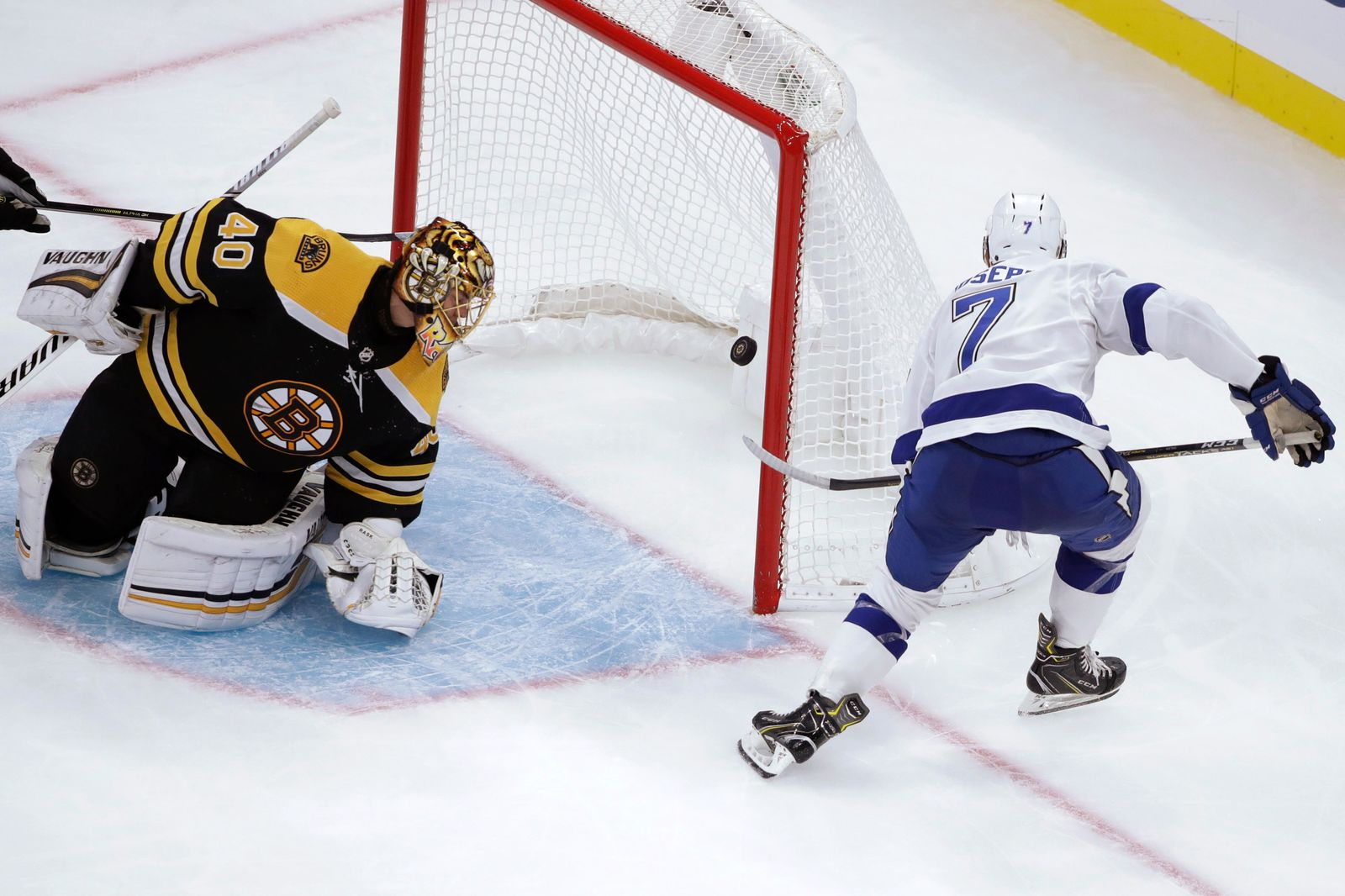 Tampa Bay Lightning right wing Mathieu Joseph (7) scores against Boston Bruins goaltender Tuukka Rask (40) during the second period of an NHL hockey game Thursday, Oct. 17, 2019, in Boston. (AP Photo/Elise Amendola)