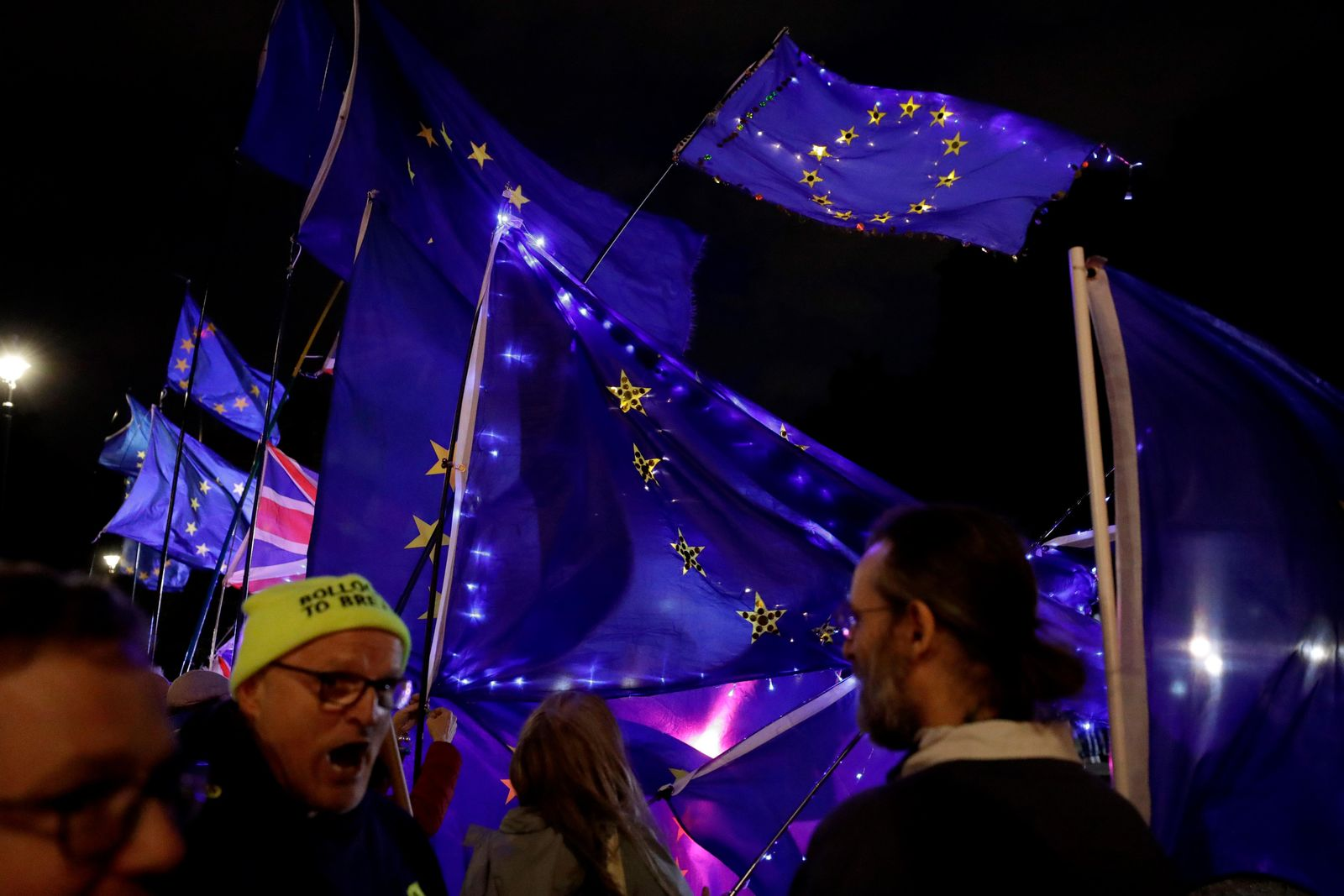 Remain in the EU supporters demonstrate with European flags opposite the Houses of Parliament in London, Wednesday, Sept. 4, 2019. (AP Photo/Matt Dunham)