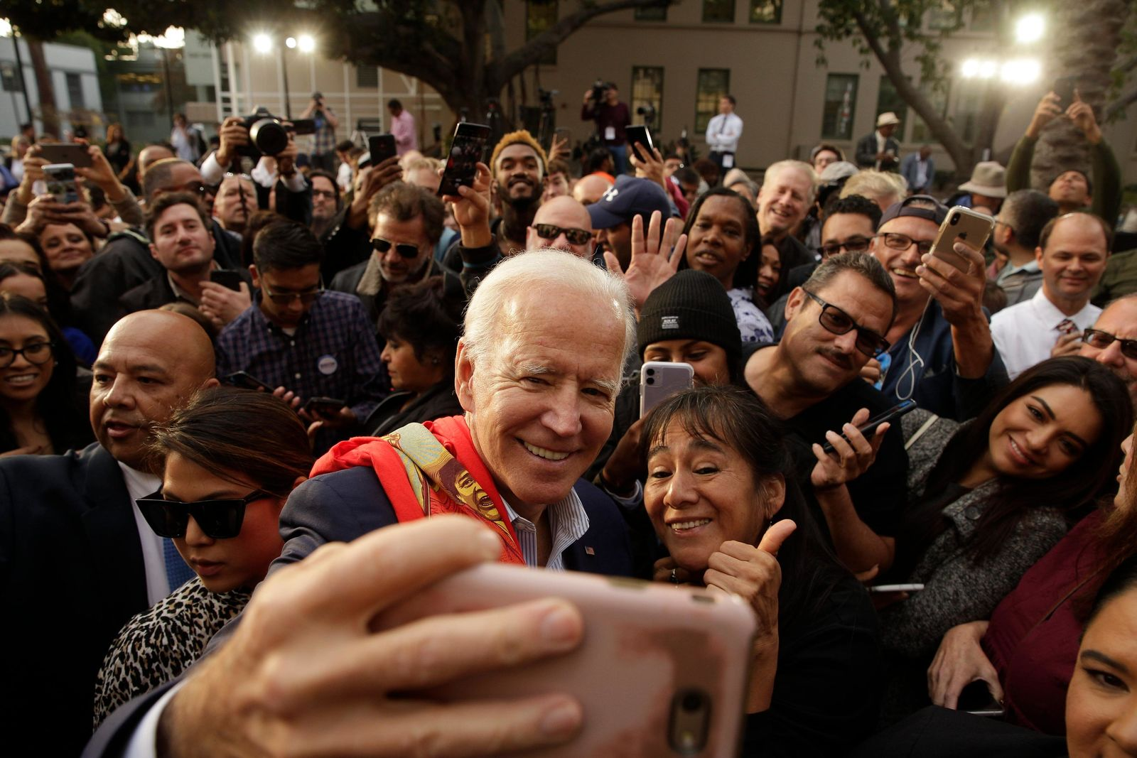 Democratic presidential candidate former Vice President Joe Biden takes selfies with supporters at a campaign rally at Los Angeles Trade Technical College in Los Angeles Thursday, Nov. 14, 2019. (AP Photo/Damian Dovarganes)