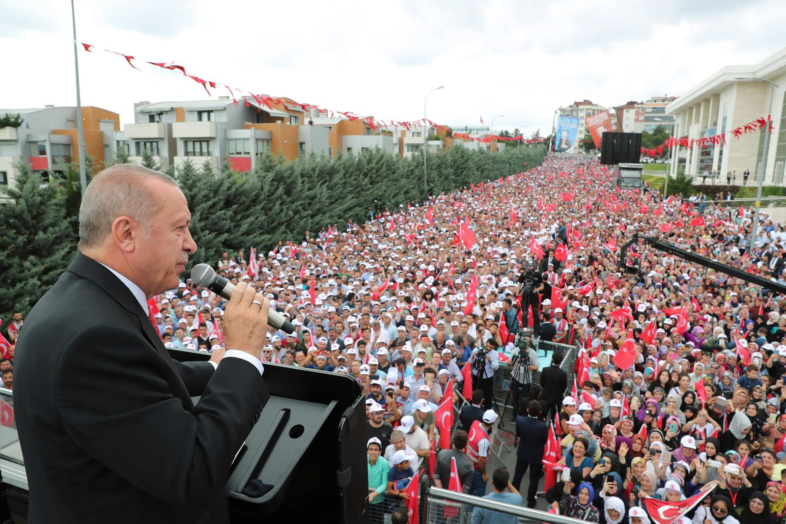 Turkey's President Recep Tayyip Erdogan, talks to supporters during a campaign rally in Istanbul for the June 23 re-run of Istanbul elections, Wednesday, June 19, 2019. (Presidential Press Service via AP, Pool)