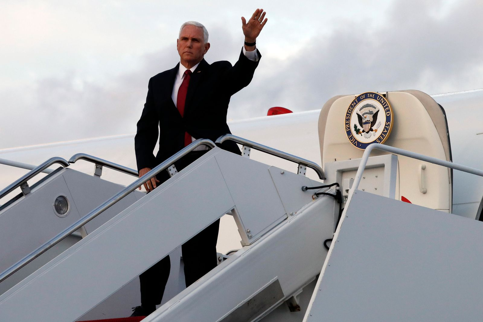 Vice President Mike Pence waves as he board Air Force Two at Andrews Air Force Base, Md., Wednesday, Oct. 16, 2019, en route to Turkey. (AP Photo/Jacquelyn Martin)