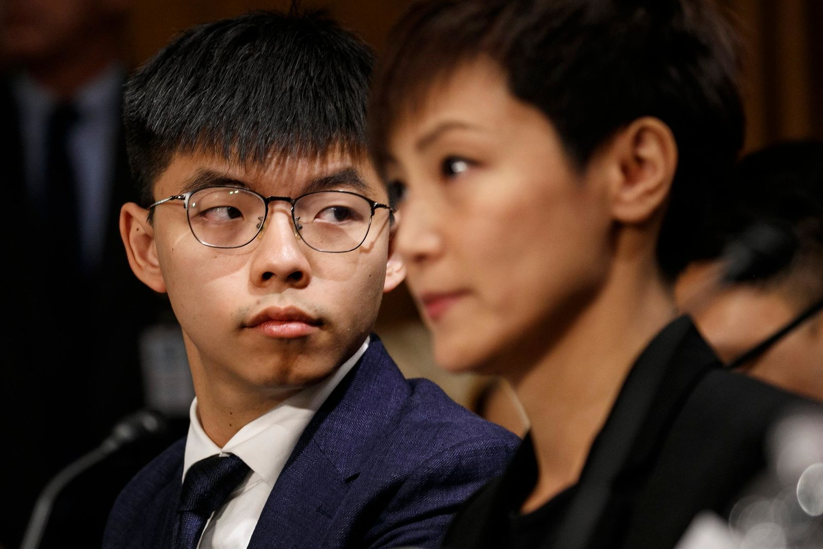 Hong Kong activists Joshua Wong, left, and Denise Ho, attend a Congressional Executive Commission on China (CECC) hearing to examine developments in Hong Kong, Tuesday, Sept. 17, 2019, on Capitol Hill in Washington. (AP Photo/Jacquelyn Martin)