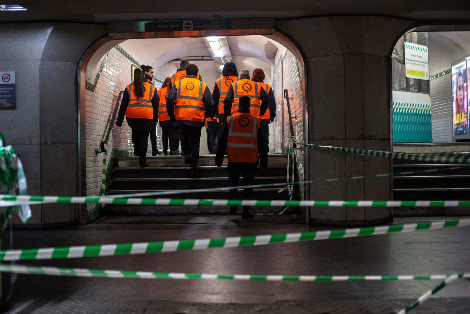 Paris subway employees walk in a corridor of a subway station in Paris, Monday, Dec.9, 2019.{ } (AP Photo/Rafael Yaghobzadeh)