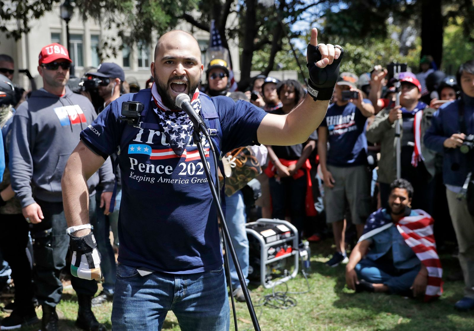 "In this April 27, 2017, file photo, right wing group Patriot Prayer leader Joey Gibson speaks during a rally in support of free speech in Berkeley, Calif. The conflict between Patriot Prayer and the so-called ""antifa"" has dominated the landscape at marches and rallies in Portland, Ore., in recent months, creating turmoil and soul-searching in the city, a liberal bastion that also hides a dark and lesser-known history of racism dating back decades. (AP Photo/Marcio Jose Sanchez, file)"