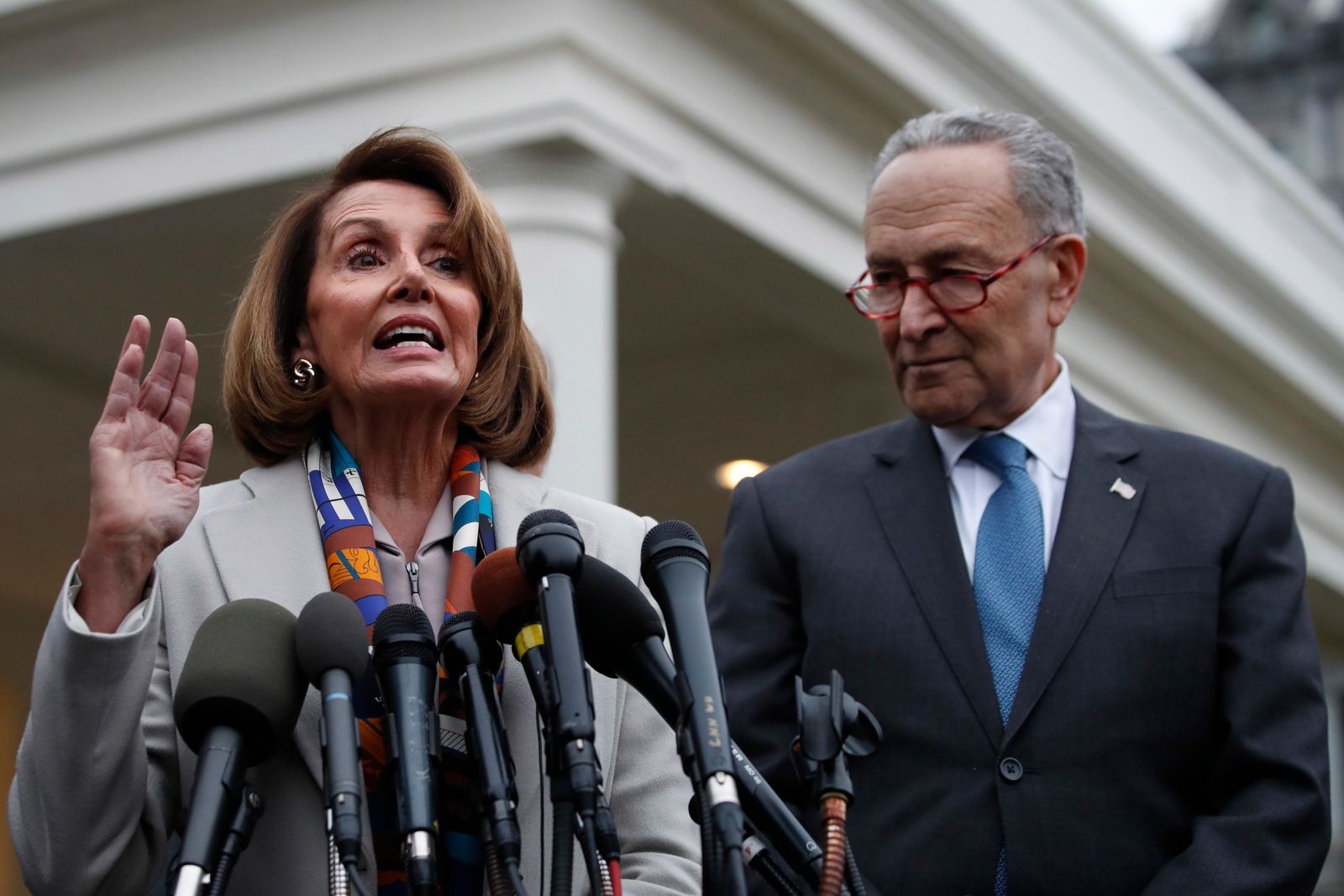 House Democratic leader Nancy Pelosi of California, left, the House Speaker-designate, and Senate Minority Leader Chuck Schumer, D-N.Y., speak to the media after meeting with President Donald Trump, Wednesday, Jan. 2, 2019. (AP Photo/Jacquelyn Martin)