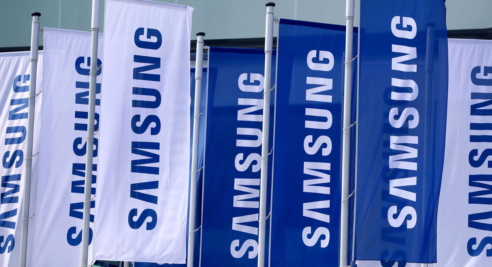 Flags of the Samsung company wave in front of a fairground entrance of the IFA 2019 tech fair in Berlin, Germany, Wednesday, Sept. 4, 2019. (AP Photo/Michael Sohn)