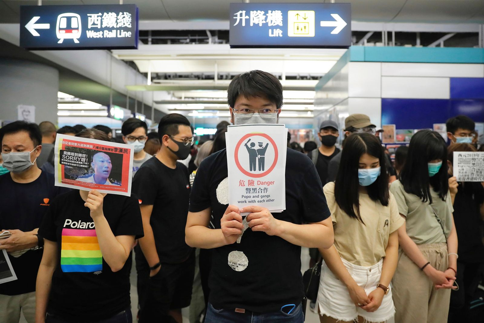 Demonstrators stand in silence during a protest at the Yuen Long MTR station in Hong Kong, Wednesday, Aug. 21, 2019.{ } (AP Photo/Kin Cheung)