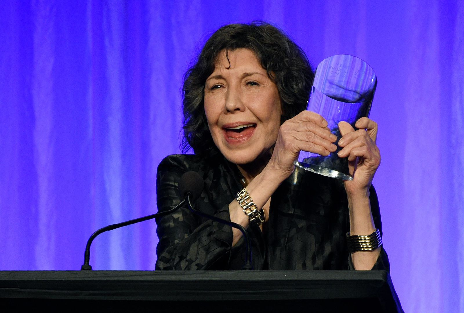"Honoree Lily Tomlin holds her award onstage at ""The Paley Honors: A Special Tribute to Television's Comedy Legends"" at the Beverly Wilshire Hotel, Thursday, Nov. 21, 2019, in Beverly Hills, Calif. (Photo by Chris Pizzello/Invision/AP)"