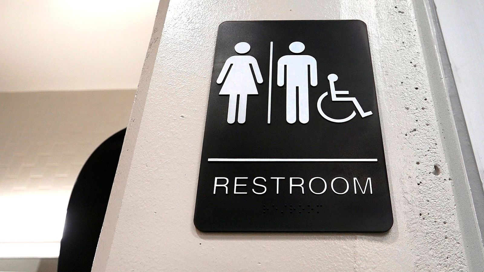 At the new Rising Hill Elementary School in Kansas City, Mo., gender neutral student bathrooms have a common sink area for washing and individual, locking, toilet stalls that can be used by boys or girls.{ } (Keith Myers/The Kansas City Star via AP)