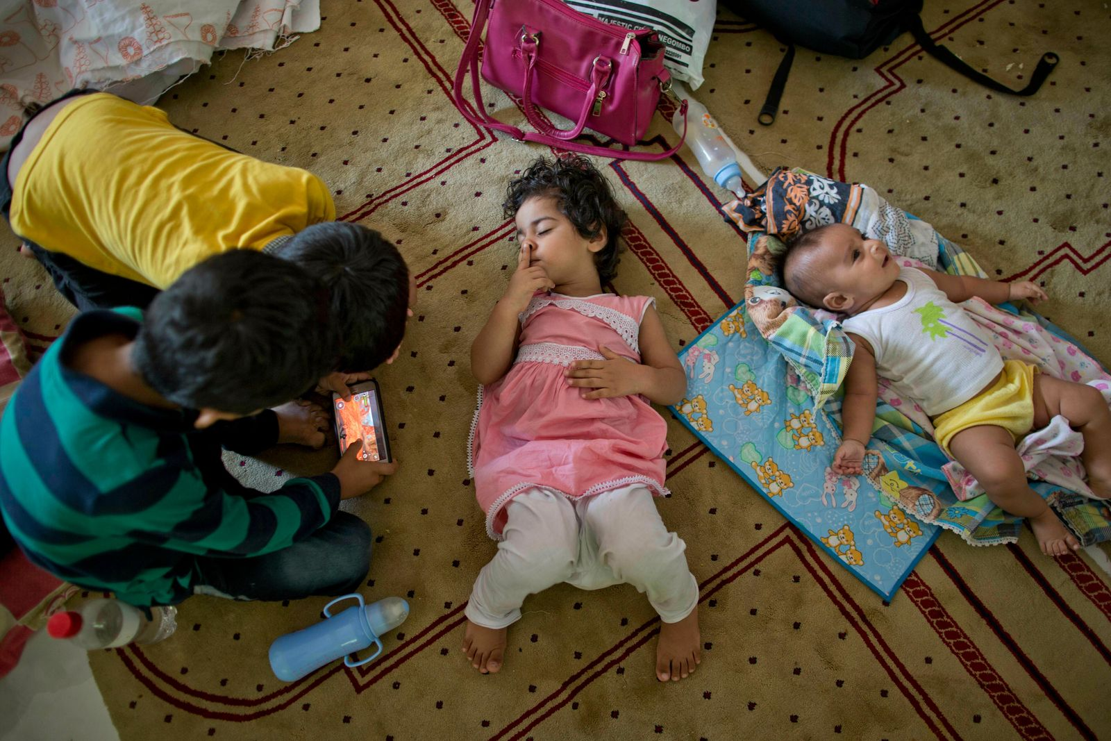 Children of Ahmadi Muslim refugees at a community center that they took refuge in Pasyala, north east of Colombo, Sri Lanka, Thursday, April 25, 2019.{ } (AP Photo/Gemunu Amarasinghe)