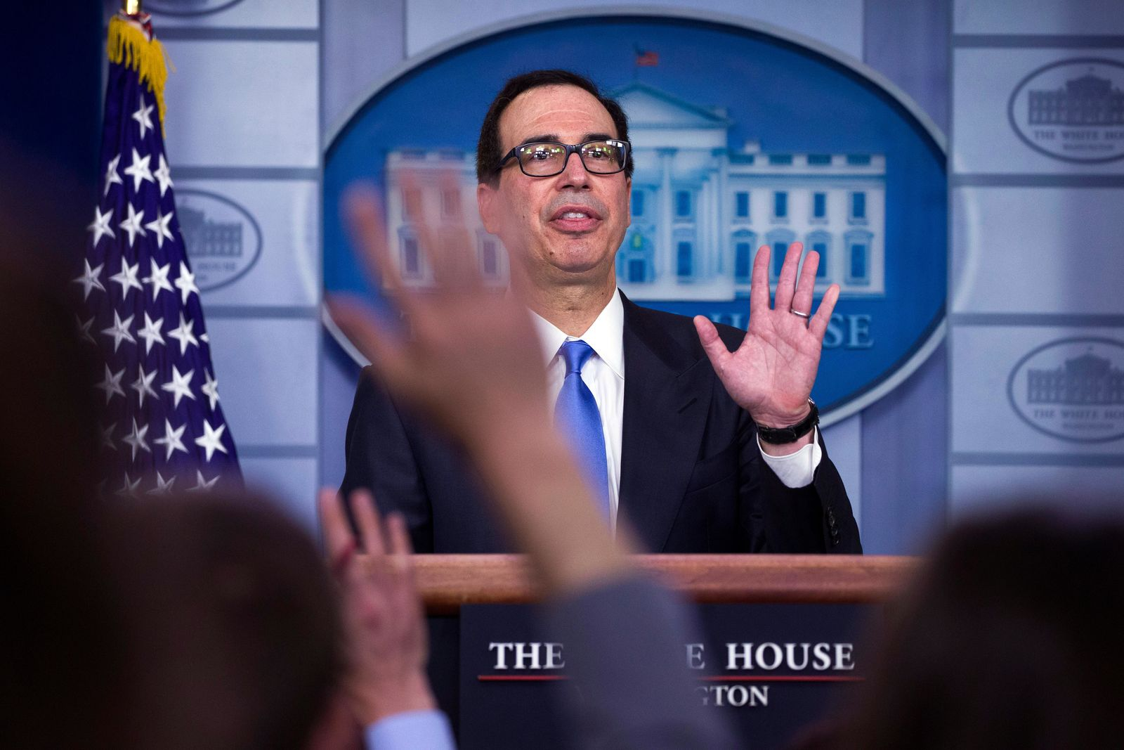 Treasury Secretary Steve Mnuchin waves as he departs after speaking to reporters about the new Iran sanctions in the Briefing Room of the White House, Monday, June 24, 2019, in Washington. (AP Photo/Alex Brandon)