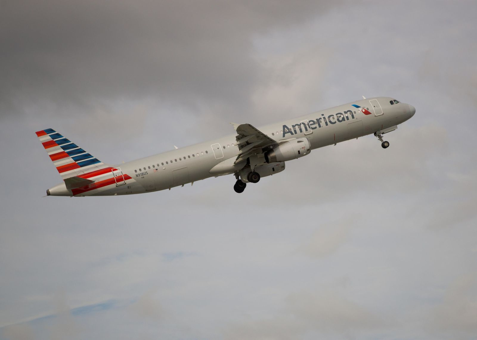In this Thursday, Nov. 29, 2018, photo, an American Airlines Airbus A321 takes off from Fort Lauderdale–Hollywood International Airport in Fort Lauderdale, Fla. On Friday, June 14, 2019, a federal judge ordered unions that represent American Airlines mechanics not to interfere in the airline's operations. (AP Photo/Wilfredo Lee)