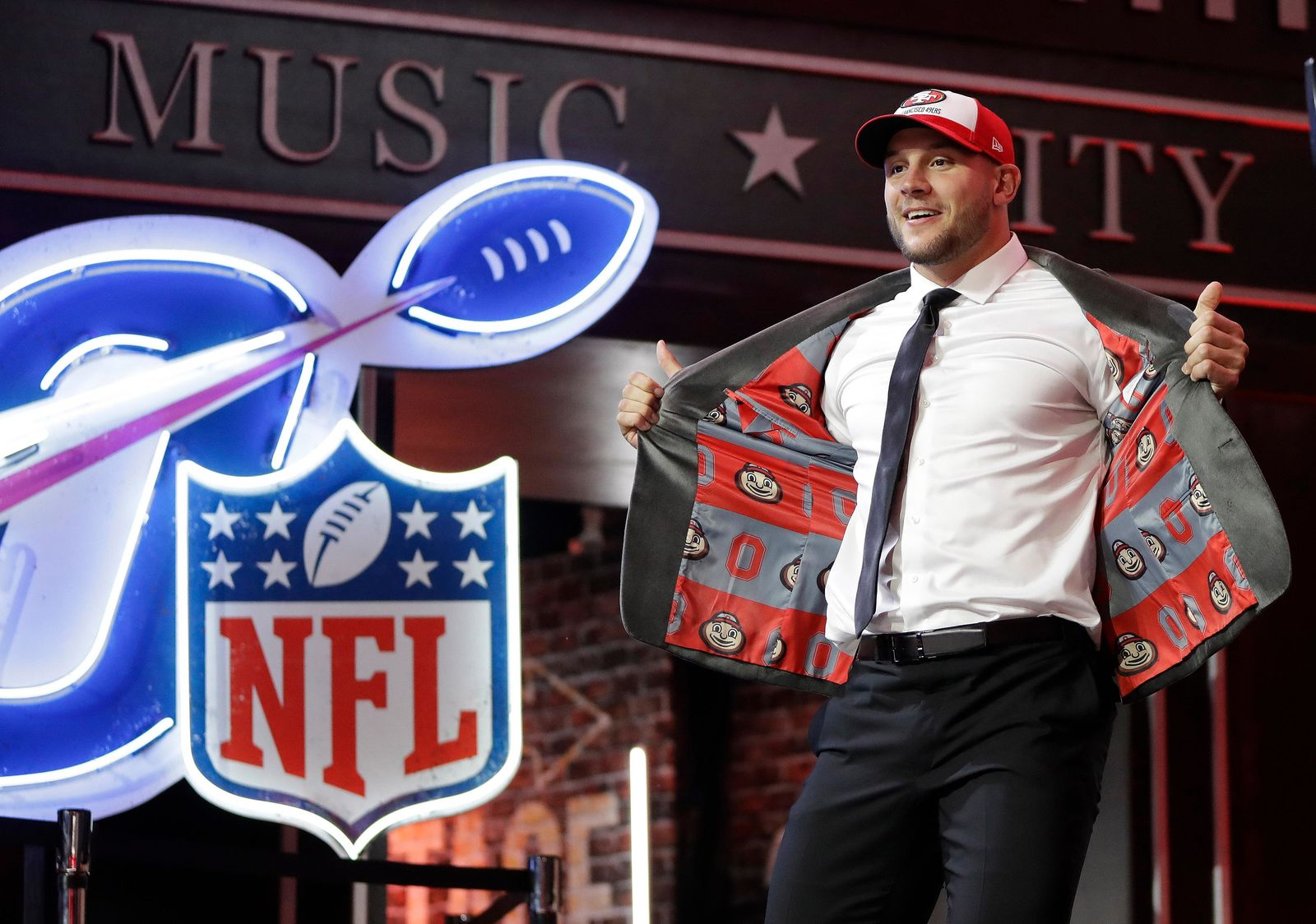 Ohio State defensive end Nick Bosa walks the stage after the San Francisco 49ers selected Bosa in the first round at the NFL football draft, Thursday, April 25, 2019, in Nashville, Tenn. (AP Photo/Mark Humphrey)
