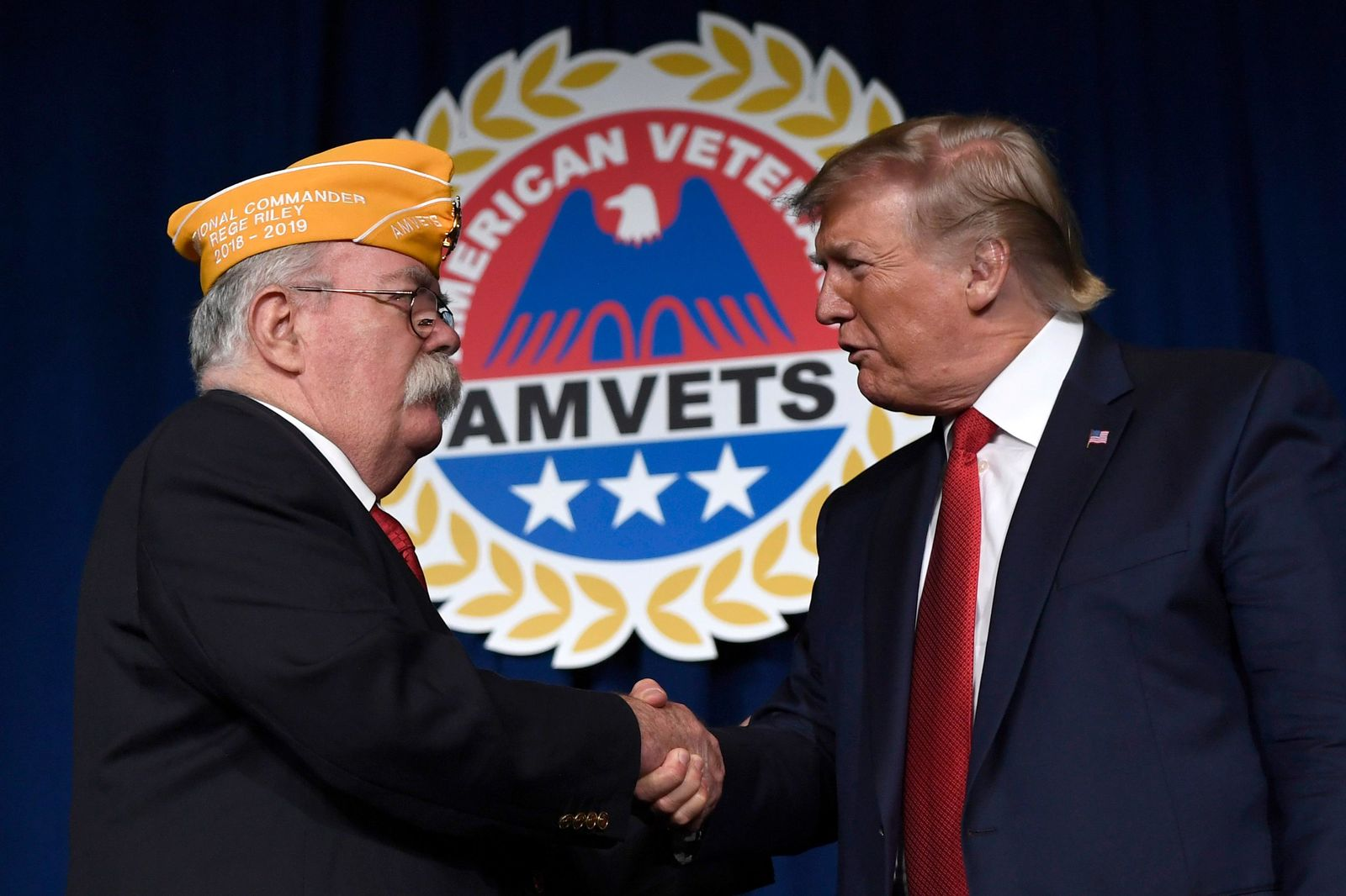 President Donald Trump greets AMVETS national commander Rege Riley at the American Veterans (AMVETS) 75th National Convention in Louisville, Ky., Wednesday, Aug. 21, 2019. (AP Photo/Susan Walsh)