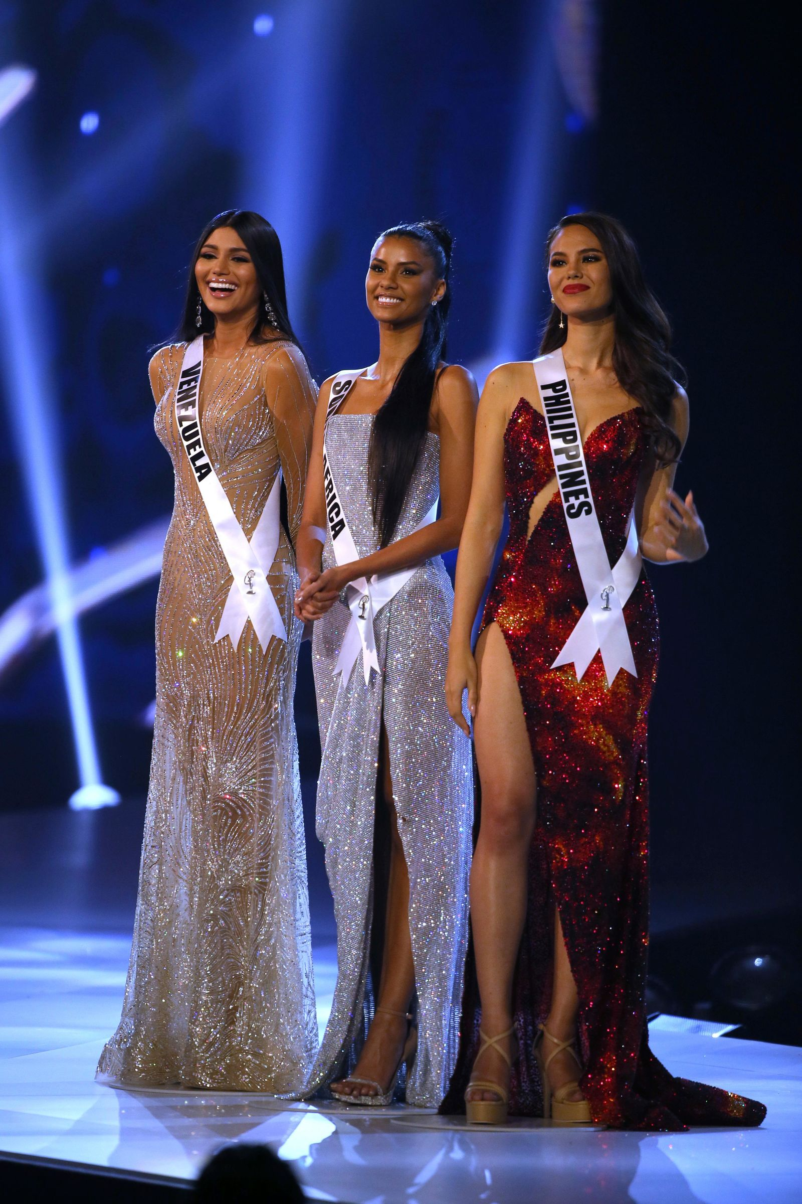 Top 3 finalists from left to right, Miss Venezuela Sthefany Gutierrez, Miss South Africa Tamaryn Green, Miss Philippines Catriona Gray, stand on the stage during the final of 67th Miss Universe competition in Bangkok, Thailand, Monday, Dec. 17, 2018.(AP Photo/Gemunu Amarasinghe)