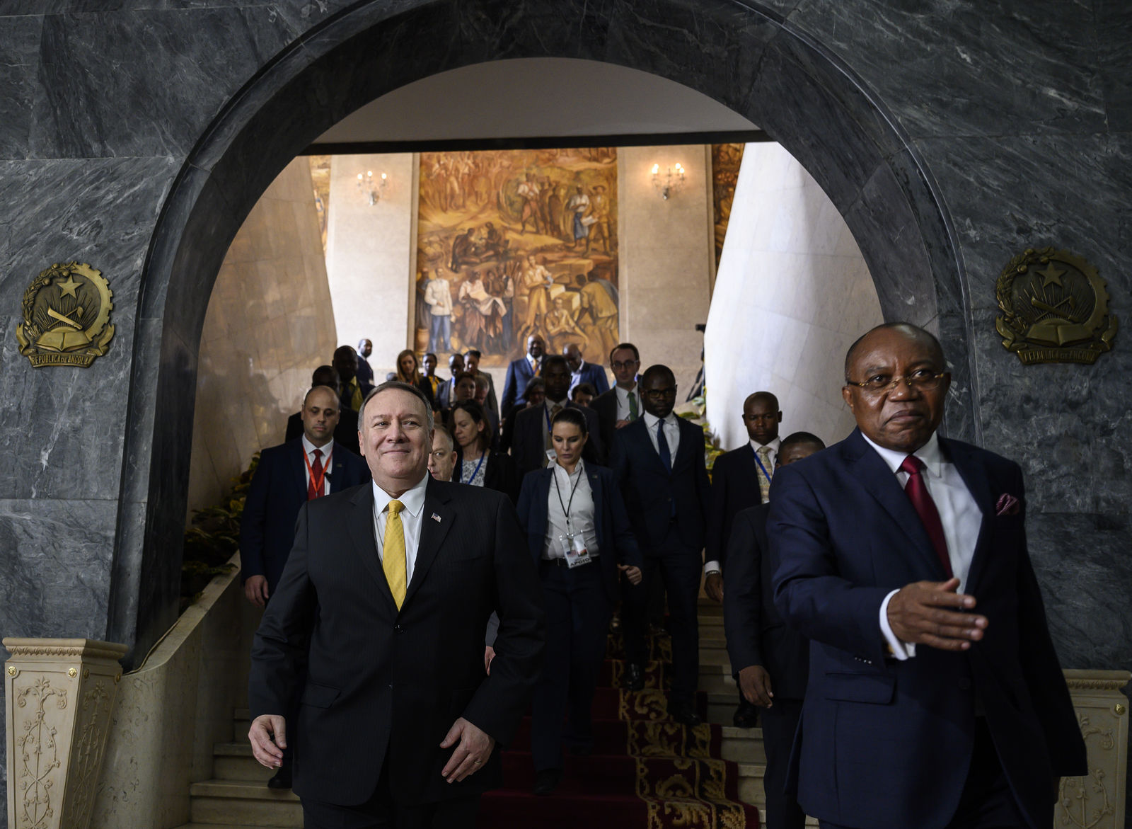 US Secretary of State Mike Pompeo, left, leaves with Angola Foreign Minister, Manuel Domingos Augusto after a press conference at the Ministry of Foreign Affairs in Luanda, Angola, Monday Feb. 17, 2020. (Andrew Caballero-Reynolds/Pool via AP)