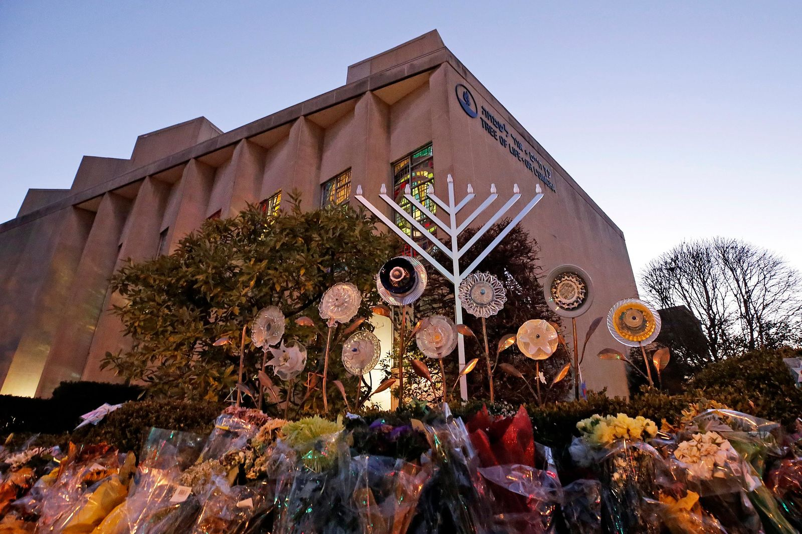 File - In this Sunday, Dec. 2, 2018 file photo, a menorah is installed outside the Tree of Life Synagogue in preparation for a celebration service at sundown on the first night of Hanukkah, in the Squirrel Hill neighborhood of Pittsburgh. (AP Photo/Gene J. Puskar, File)