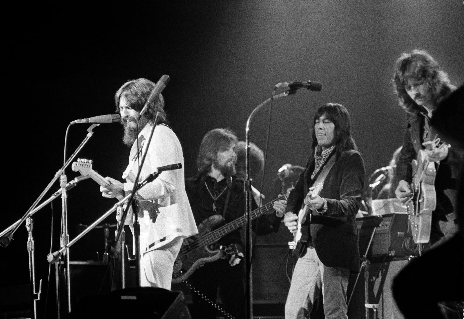 "FILE - In this Aug. 1, 1971 file photo, Jesse Ed Davis, center right, a guitarist of Kiowa and Comanche ancestry, performs with George Harrison, left, formerly of the Beatles, at the Concert For Bangladesh at Madison Square Garden in New York City. Klaus Voorman is on bass, second from left, and Eric Clapton is at right. ""RUMBLE: The Indians Who Rocked the World,"" a new PBS Independent Lens documentary set to air Monday, Jan 21, 2019, shows how Native Americans laid the foundations to rock, blues and jazz. (AP Photo/Jim Wells, File)"