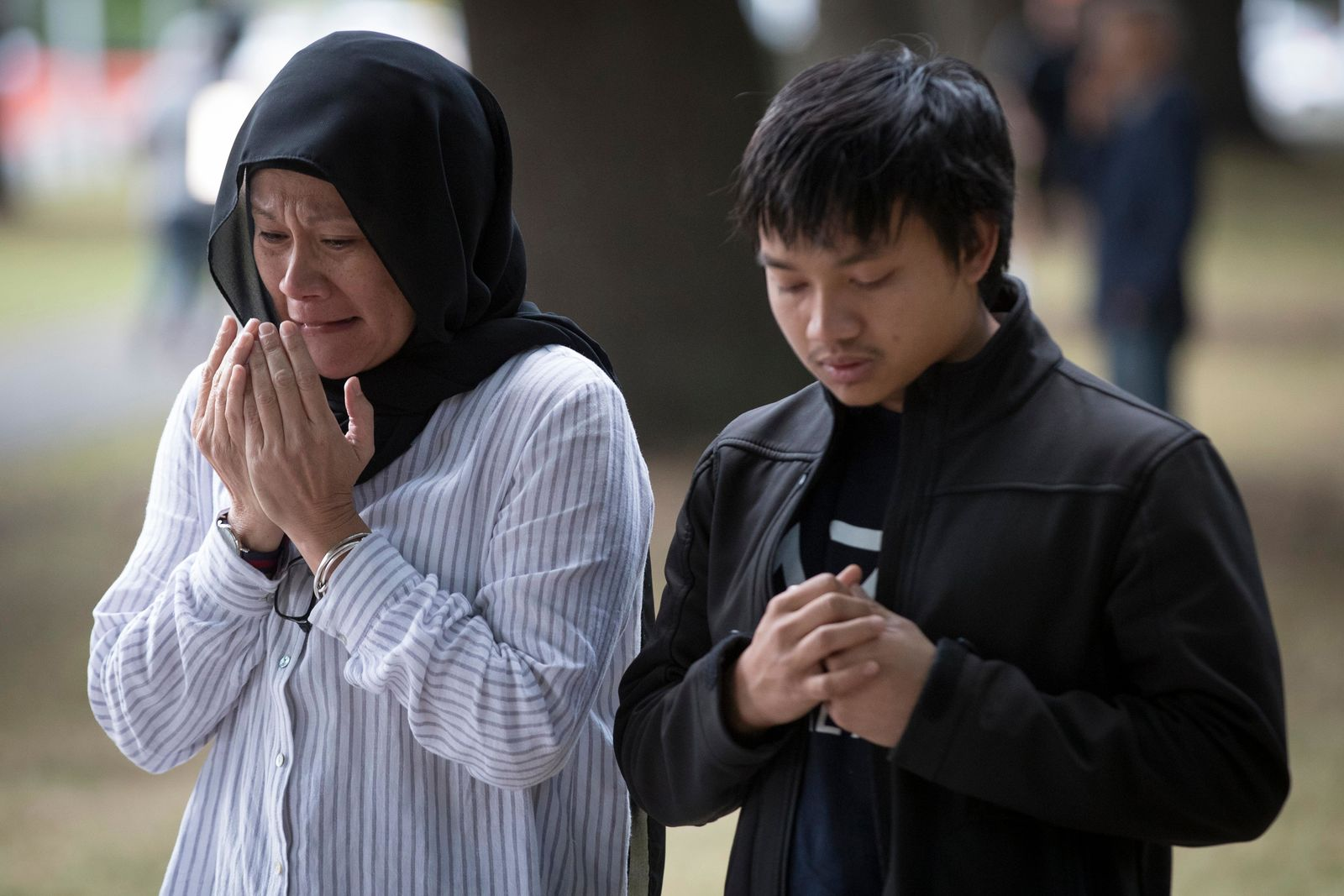 Mourners react at a memorial site for victims in last week's mass shooting near the Al Noor mosque in Christchurch, New Zealand, Tuesday, March 19, 2019. (AP Photo/Vincent Thian)