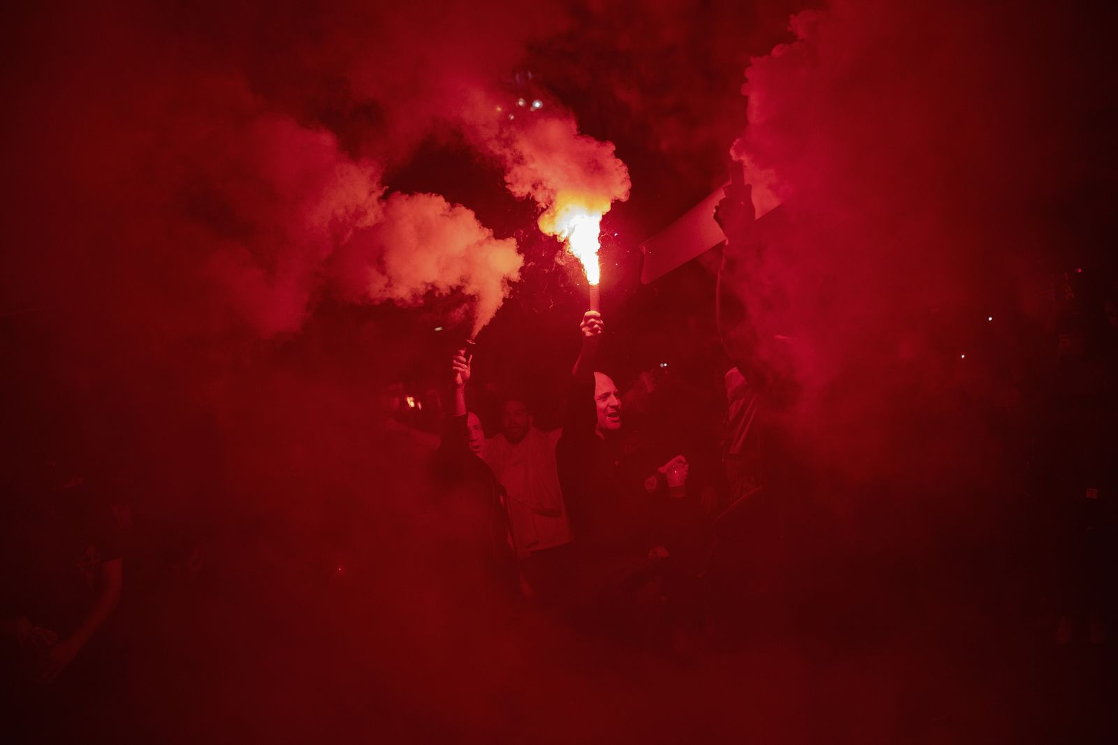 Right wing pro-Spanish unity supporters light flares during a demonstration in Barcelona, Spain, Thursday, Oct. 17, 2019. (AP Photo/Bernat Armangue)