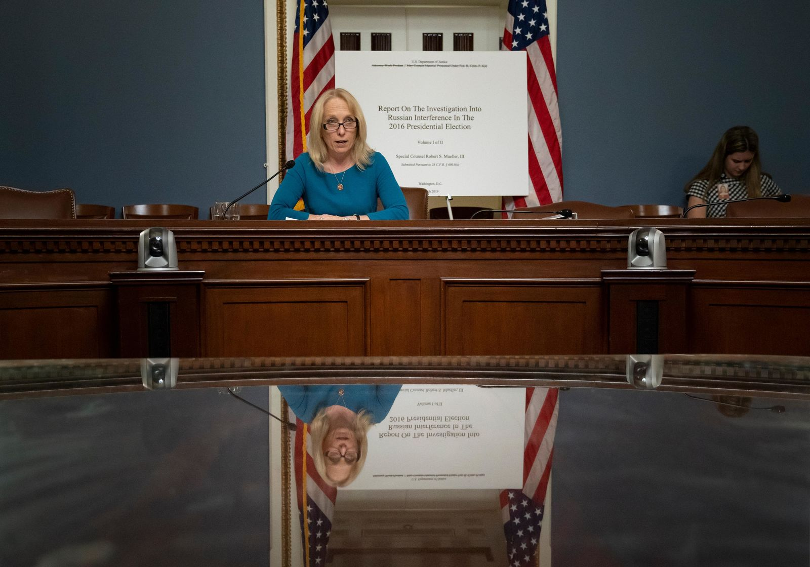 House Judiciary Committee member Rep. Mary Gay Scanlon, D-Pa., begins a complete reading of the report by special counsel Robert Mueller on Russian election interference, at the Capitol in Washington, Thursday, May 16, 2019. (AP Photo/J. Scott Applewhite)