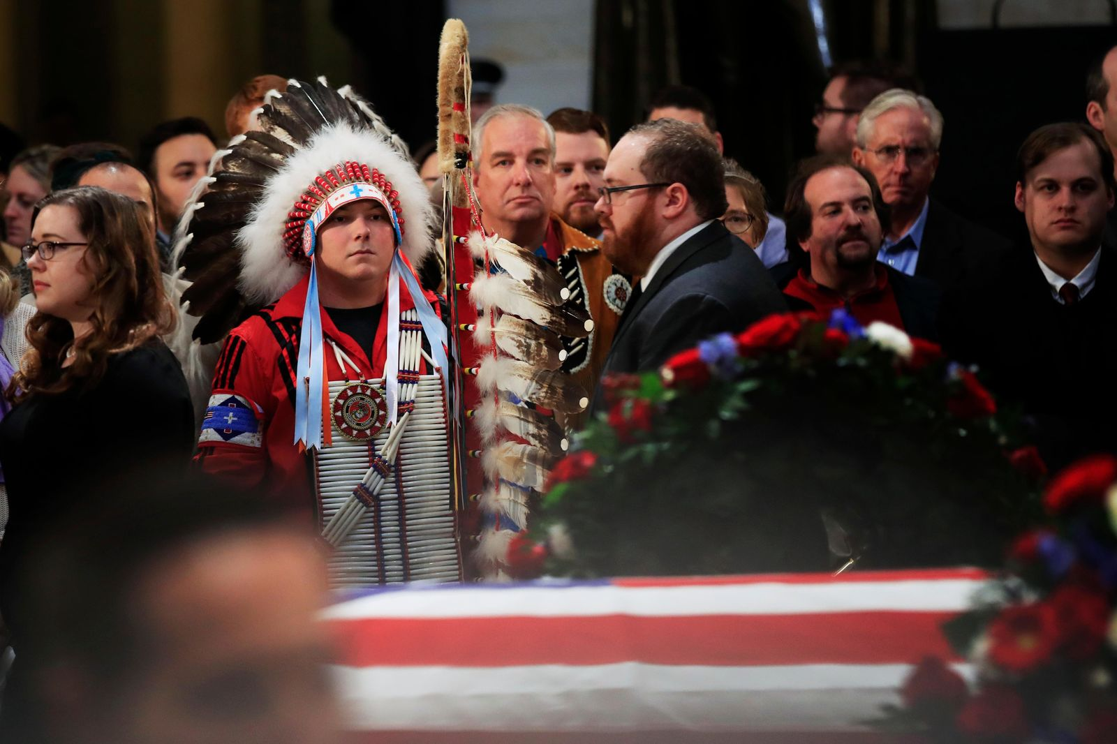 Native Americans Donald Woody, left, and Warren Stade of the Shakopee Mdewakanton Sioux Community tribe in Prior Lake, Minn., pay their last respects to former President George H.W. Bush as he lies in state at the U.S. Capitol in Washington, Tuesday, Dec. 4.{ } (AP Photo/Manuel Balce Ceneta)