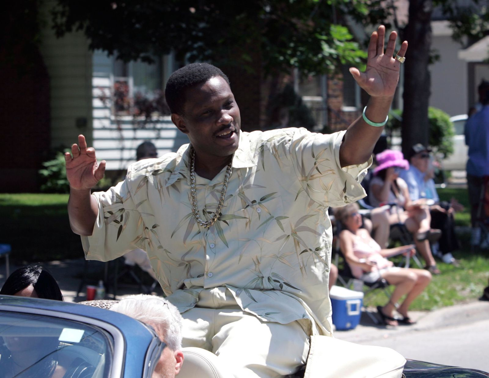 FILE - In this June 10, 2007, file photo, Pernell Whitaker waves to the crowd during a parade before he was inducted into the International Boxing Hall of Fame in Canastota, N.Y.. (AP Photo/Mike Groll, File)