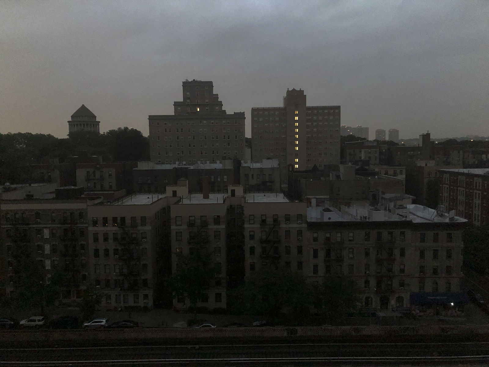 Buildings in Harlem sit dark during a power outage early, Friday, Aug. 7, 2020, in New York.{ } (AP Photo/Candice Choi)