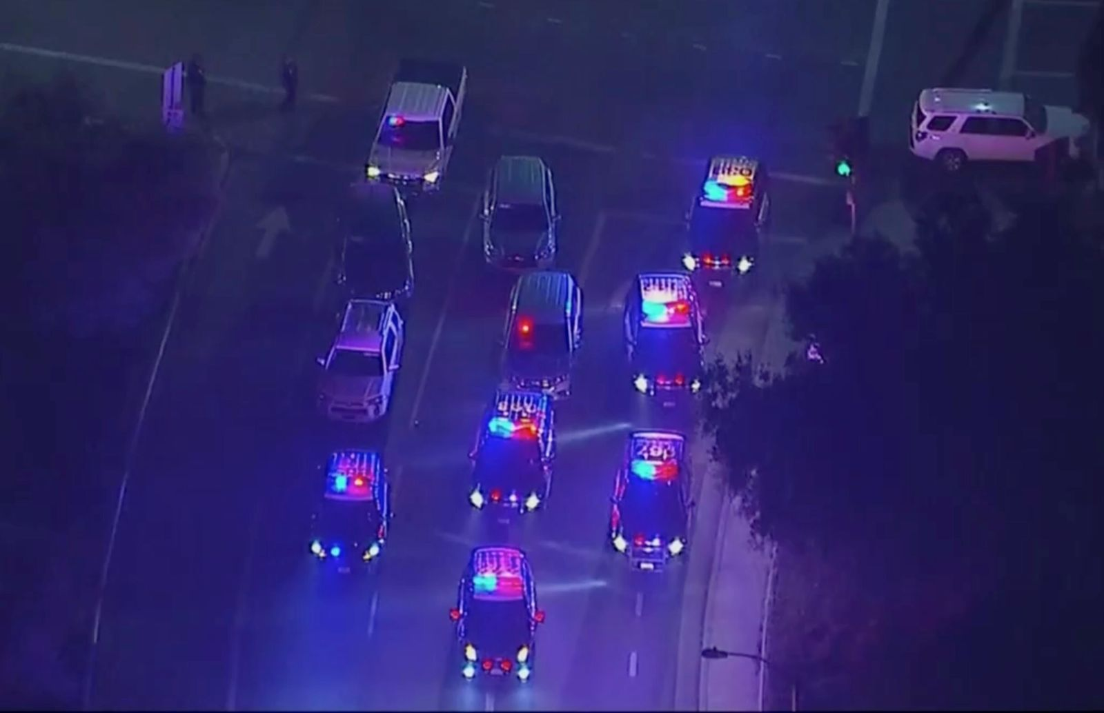 In this image made from aerial video, police vehicles block an intersection in the vicinity of a shooting in Thousand Oaks, California, early Thursday, Nov. 8, 2018. (KABC via AP)