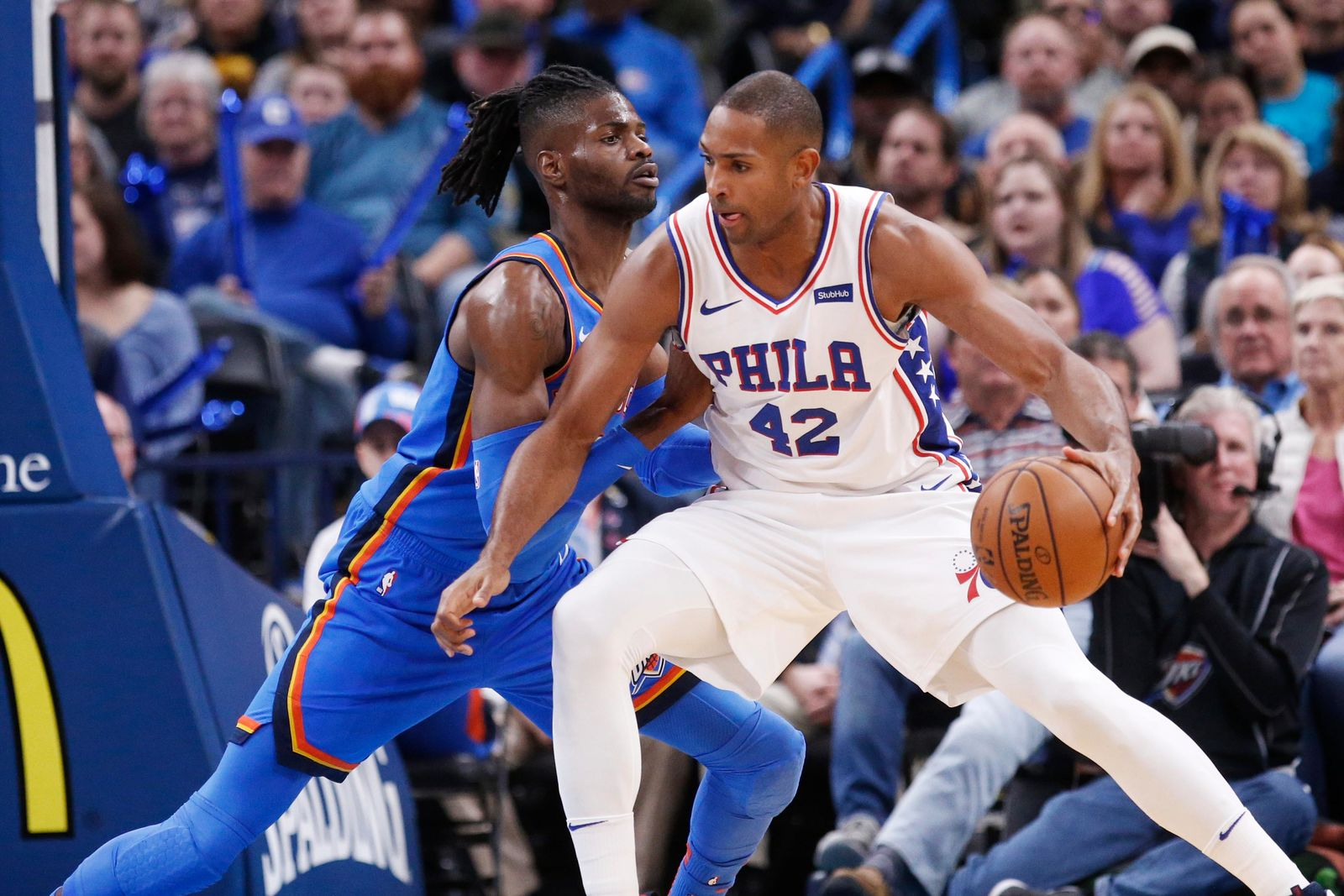 Philadelphia 76ers forward Al Horford (42) drives against Oklahoma City Thunder forward Nerlens Noel during the first half of an NBA basketball game Friday, Nov. 15, 2019, in Oklahoma City. (AP Photo/Sue Ogrocki)