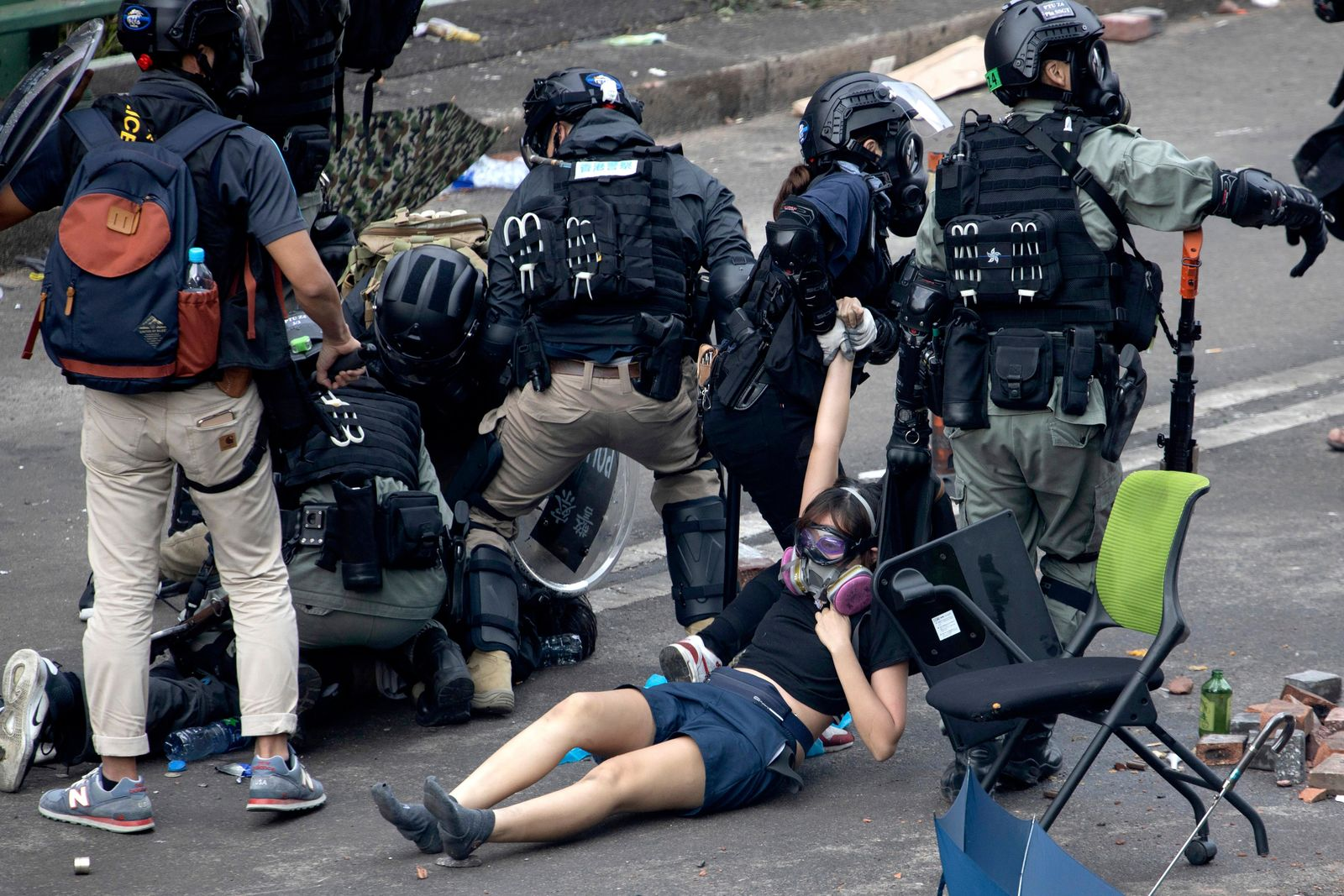 Police in riot gear drag a protester who was trying to flee from the Hong Kong Polytechnic University in Hong Kong, Monday, Nov. 18, 2019. (AP Photo/Ng Han Guan)