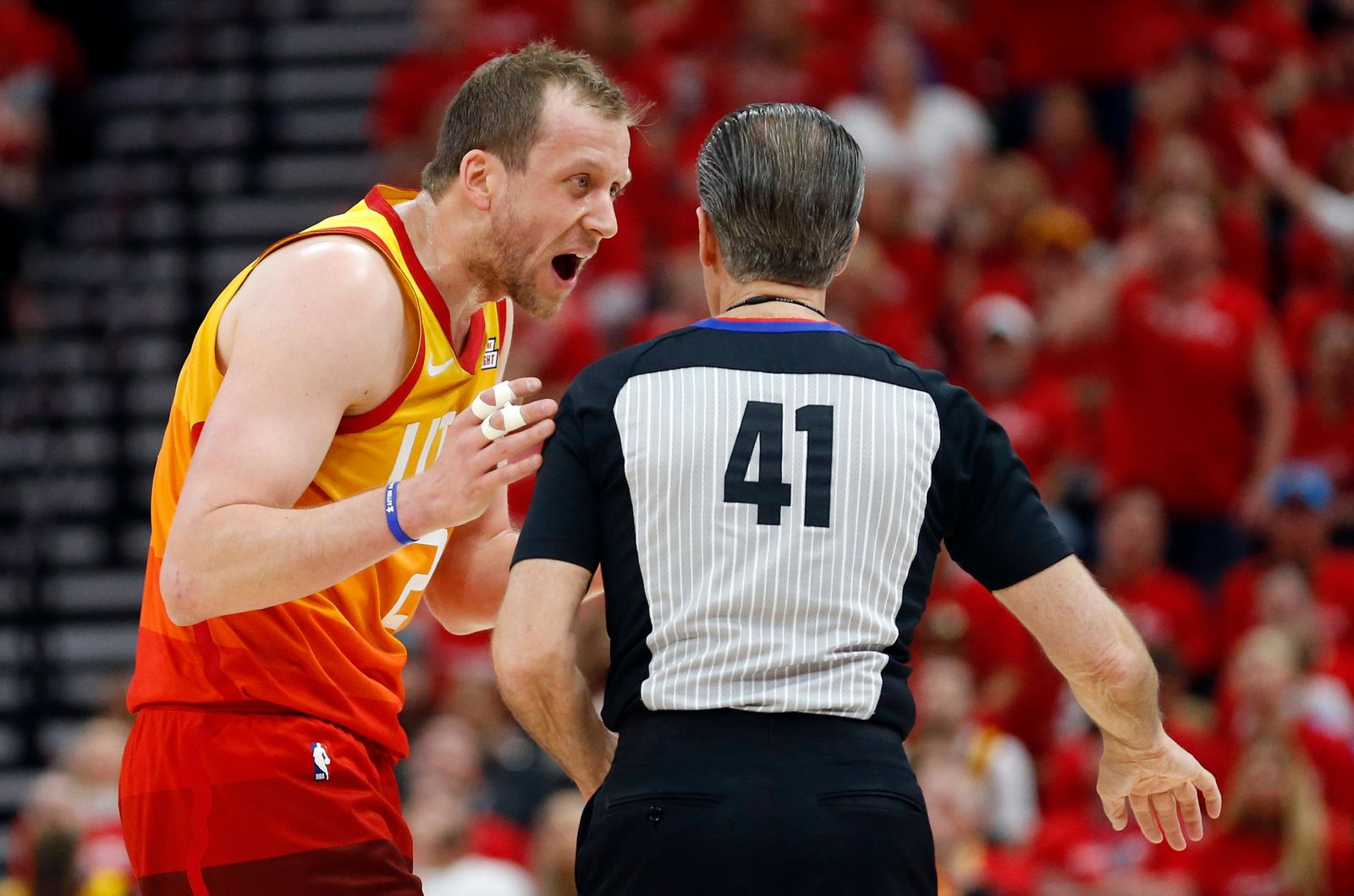 Utah Jazz forward Joe Ingles, left, argues with referee Ken Mauer (41) in the first half during an NBA basketball game against the Houston Rockets Saturday, April 20, 2019, in Salt Lake City. (AP Photo/Rick Bowmer)