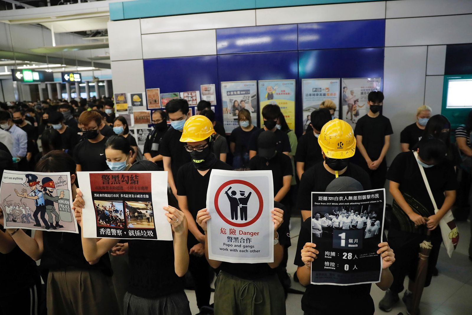 Demonstrators stand during a protest at the Yuen Long MTR station, where demonstrators and others were violently attacked by men in white T-shirts following an earlier protest in July, in Hong Kong, Wednesday, Aug. 21, 2019.{ } (AP Photo/Kin Cheung)