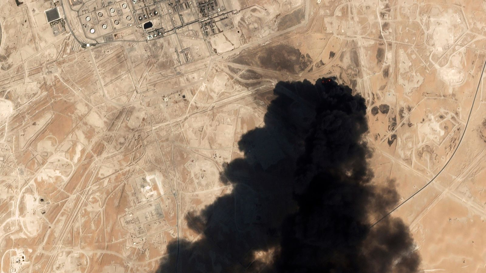 FILE - In this Saturday, Sept. 14, 2019 file photo, a satellite image from Planet Labs Inc. shows thick black smoke rising from Saudi Aramco's Abqaiq oil processing facility in Buqyaq, Saudi Arabia.{ } (Planet Labs Inc via AP, File)