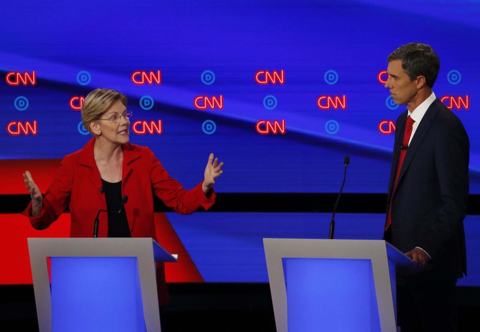 Former Texas Rep. Beto O'Rourke listens as Sen. Elizabeth Warren, D-Mass., speaks during the first of two Democratic presidential primary debates hosted by CNN Tuesday, July 30, 2019, in the Fox Theatre in Detroit. (AP Photo/Paul Sancya)