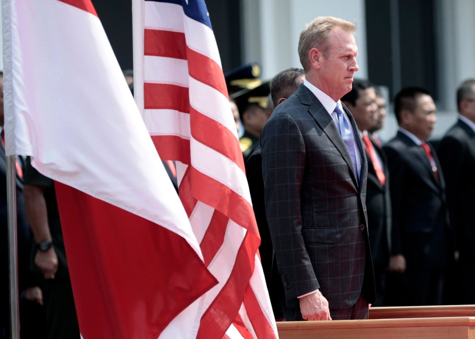 FILE - Acting U.S. Secretary of Defense Patrick Shanahan, center, listens to U.S. and Indonesian national anthems prior to his bilateral meeting with Indonesian Defense Minister Ryamizard Ryacudu in Jakarta, Indonesia, Thursday, May 30, 2019. (AP Photo/Dita Alangkara)