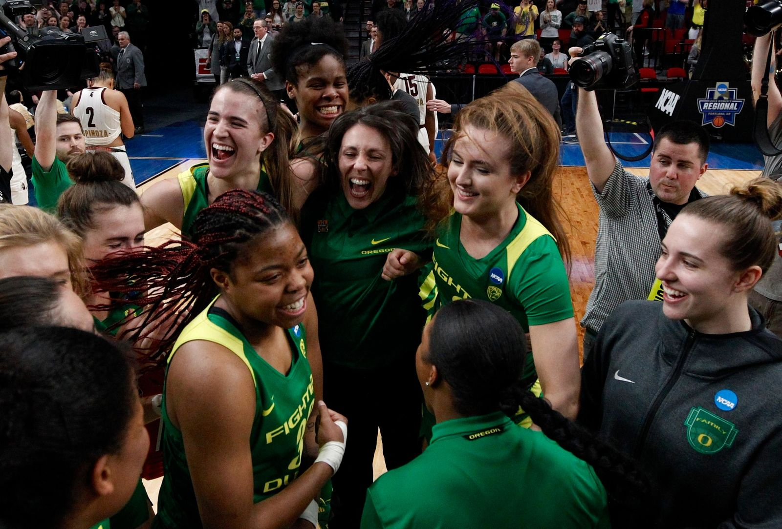 Oregon players celebrate a regional final victory over Mississippi State in the NCAA women's college basketball tournament Sunday, March 31, 2019, in Portland, Ore. (AP Photo/Steve Dipaola)
