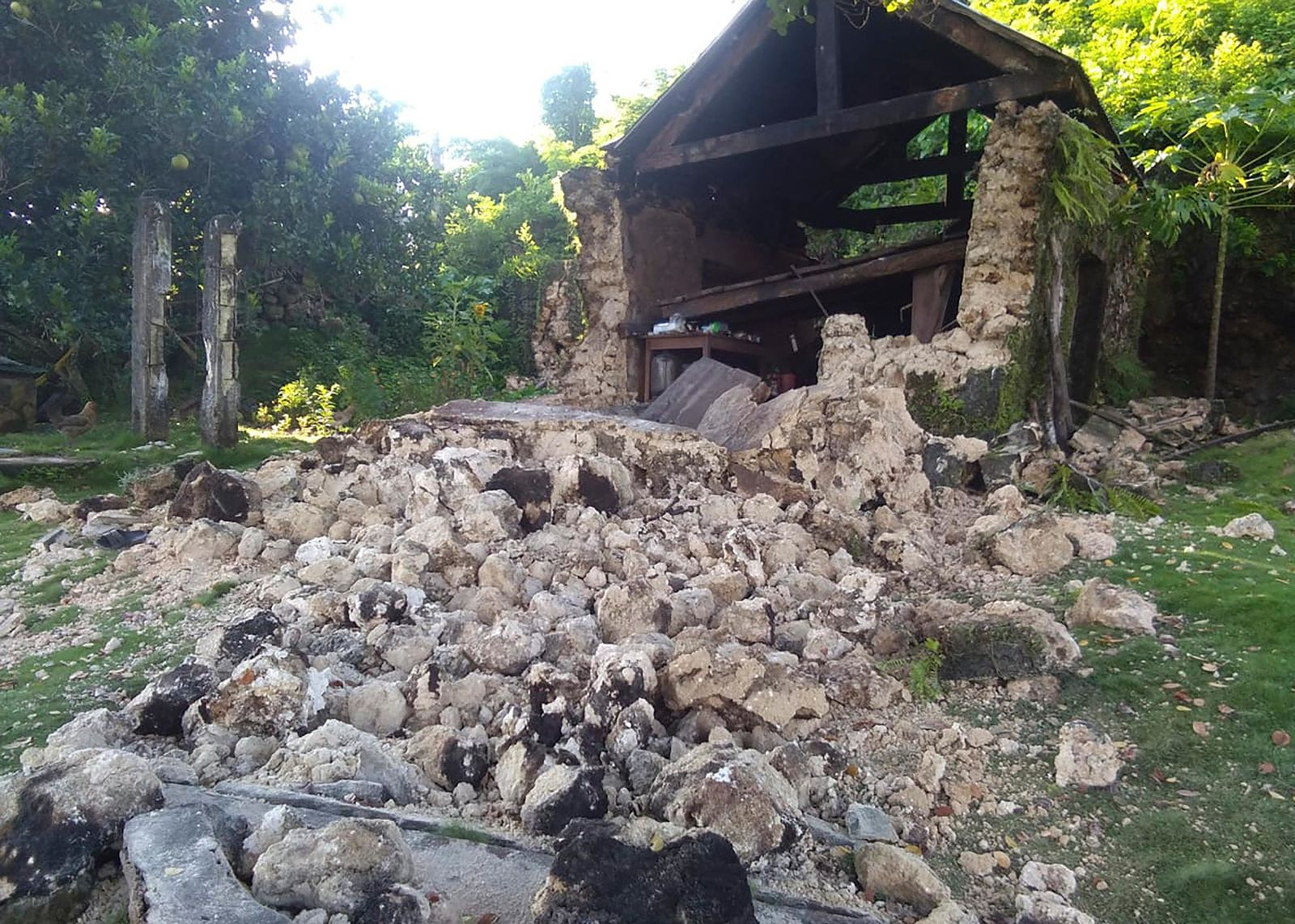 Damaged houses lie in Itbayat town, Batanes islands, northern Philippines on Saturday, July 27, 2019. Two strong earthquakes hours apart struck a group of sparsely populated islands in the Luzon Strait in the northern Philippines early Saturday. (AP Photo/Agnes Salengua Nico)
