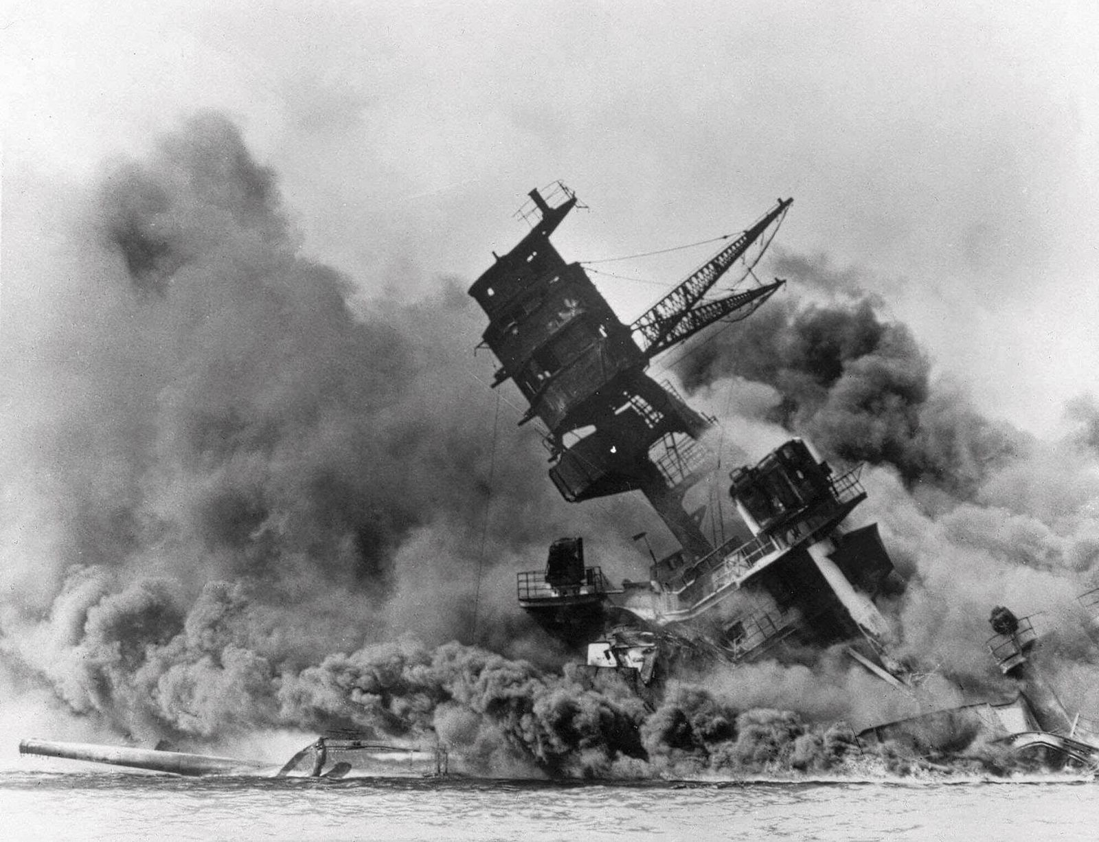 FILE - In this Dec. 7, 1941, file photo, smoke rises from the battleship USS Arizona as it sinks during the Japanese attack on Pearl Harbor, Hawaii. Survivors and members of the public are expected to gather in Pearl Harbor on Saturday, Dec. 7, 2019, to remember those killed when Japanese planes bombed the Hawaii naval base 78 years ago and launched the U.S. into World War II. Organizers plan for about a dozen survivors of the attack to attend the annual ceremony, the youngest of whom are now in their late 90s. (AP Photo, File)